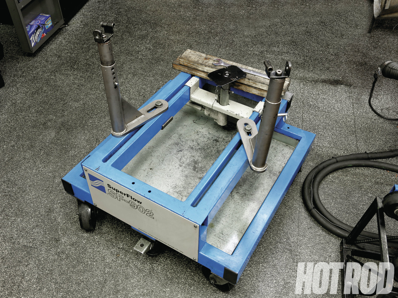 [01] During dyno testing, a docking cart supports the engine and positions it in front of the water brake. The cart's two side stands attach to the motor mounts and can easily be adjusted for width and height. A third stand supports the rear of the oil pan and adjusts the front-to-rear pitch of the engine. Heavy-duty casters allow rolling around an engine with ease.