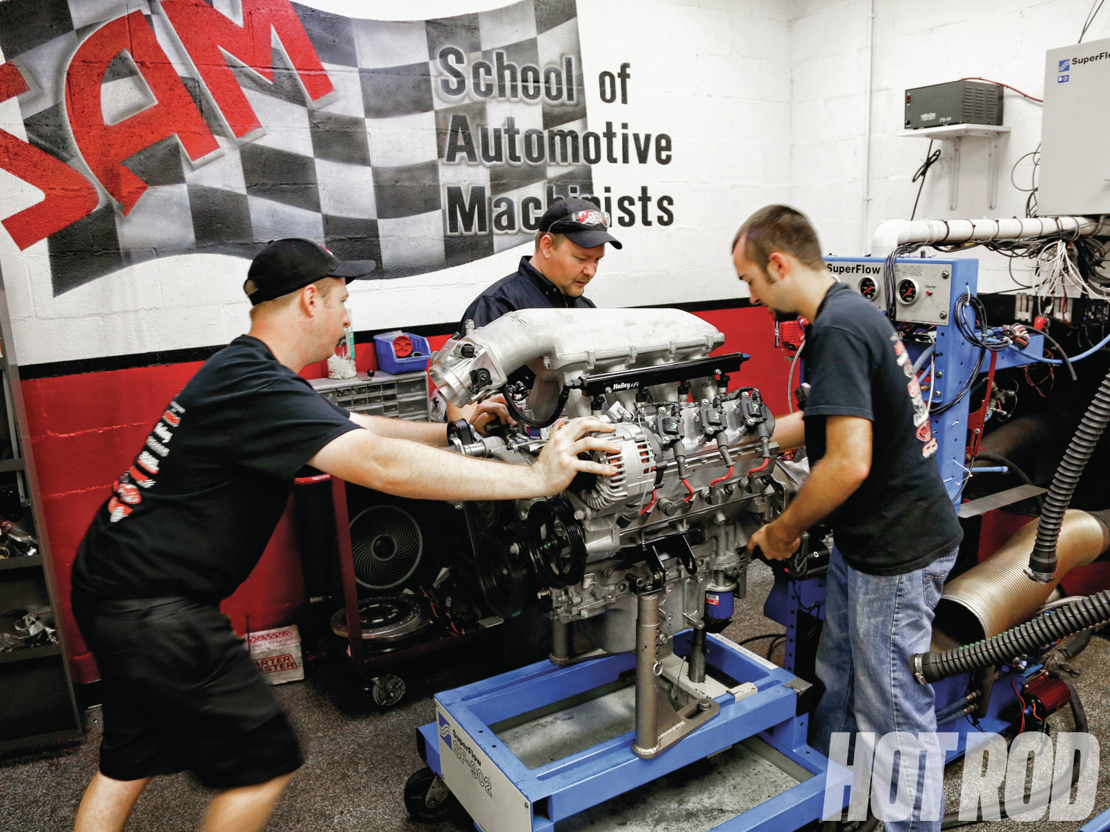 [06] Just like when bolting a transmission to an engine, engaging the flywheel hub onto the dyno's input shaft requires a bit of finagling. There's not much to it other than brute strength, wiggling, and patience.