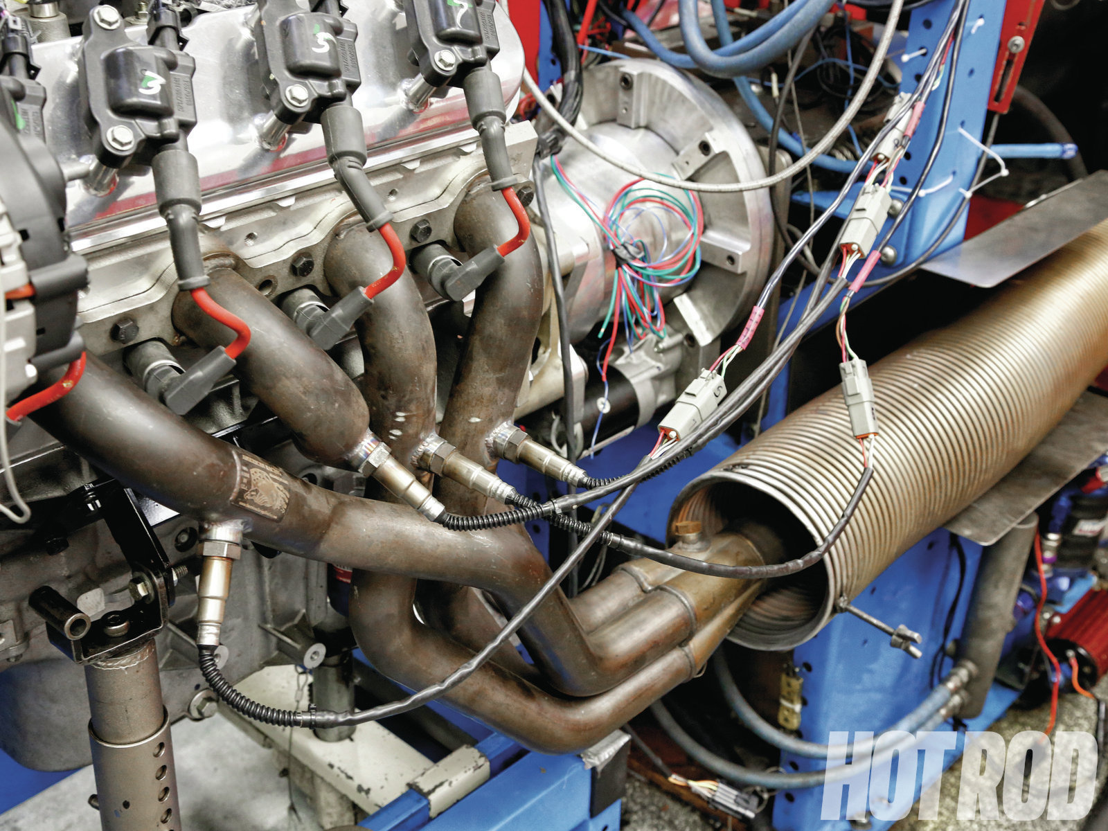 [12] In SAM's dyno cell, the headers empty exhaust into two corrugated, stainless-steel tubes that direct gasses into two giant mufflers located in an adjacent cell. The exhaust is then routed to the roof and pulled outside the building with two large fans. In other types of cells, exhaust empties directly into the room and gets sucked out by heavy-duty ventilation fans. Poor ventilation can easily reduce power output by 10 percent or more, as the engine can become contaminated with its own exhaust fumes.