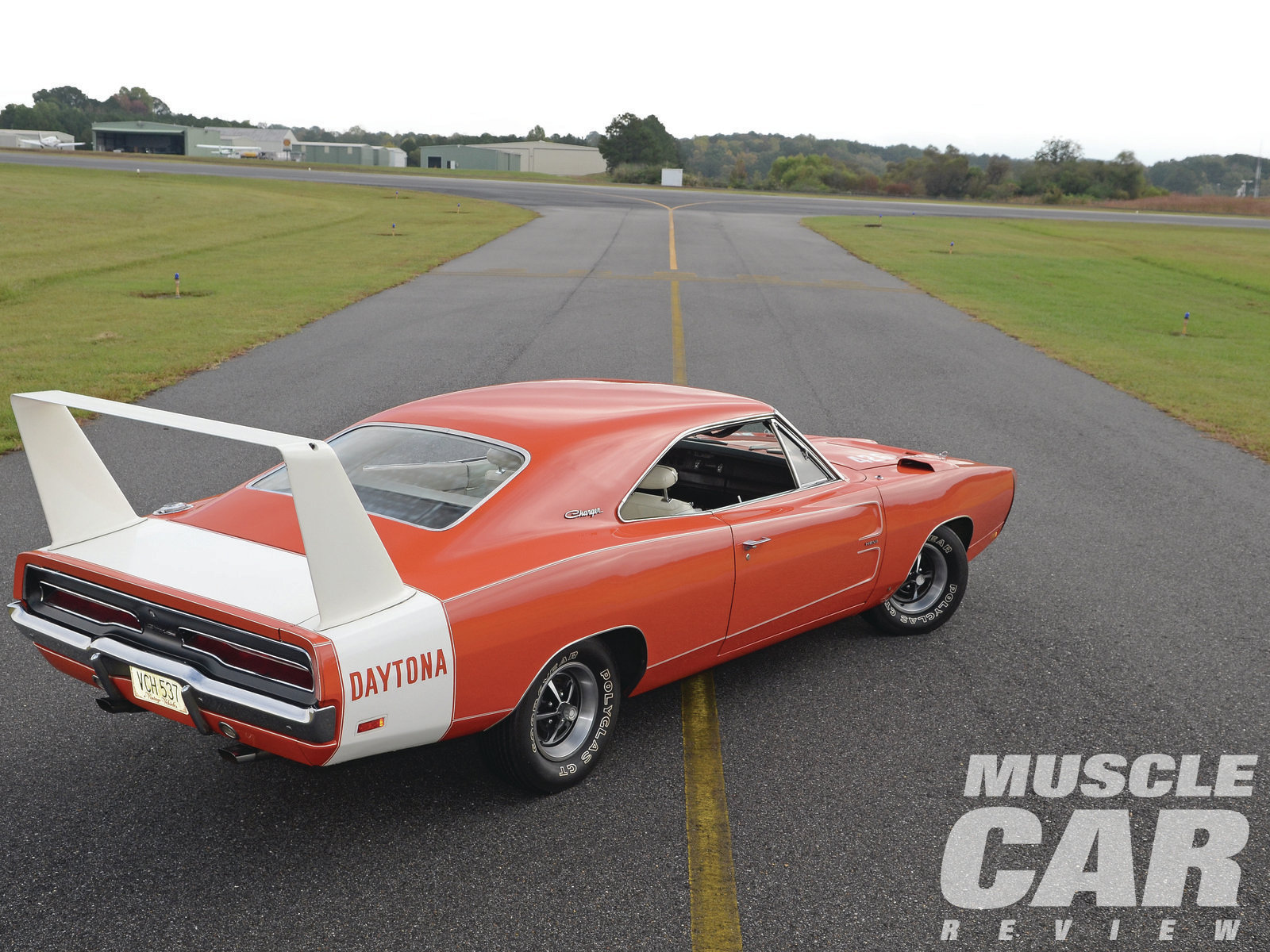 The combination of Hemi Orange paint with a white wing and white interior makes this car pretty impressive.