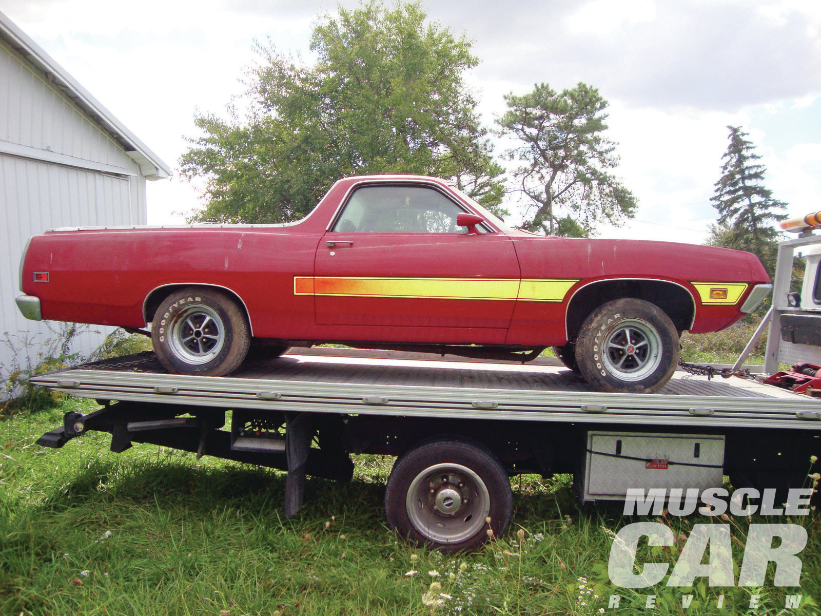 """""""The original color was Medium Gold Metallic with a Medium Ginger vinyl bench seat,"""" says Rick Parker, the Ranchero's new owner. Somebody repainted the car red with a factory laser stripe and changed the interior to black bucket seats"""