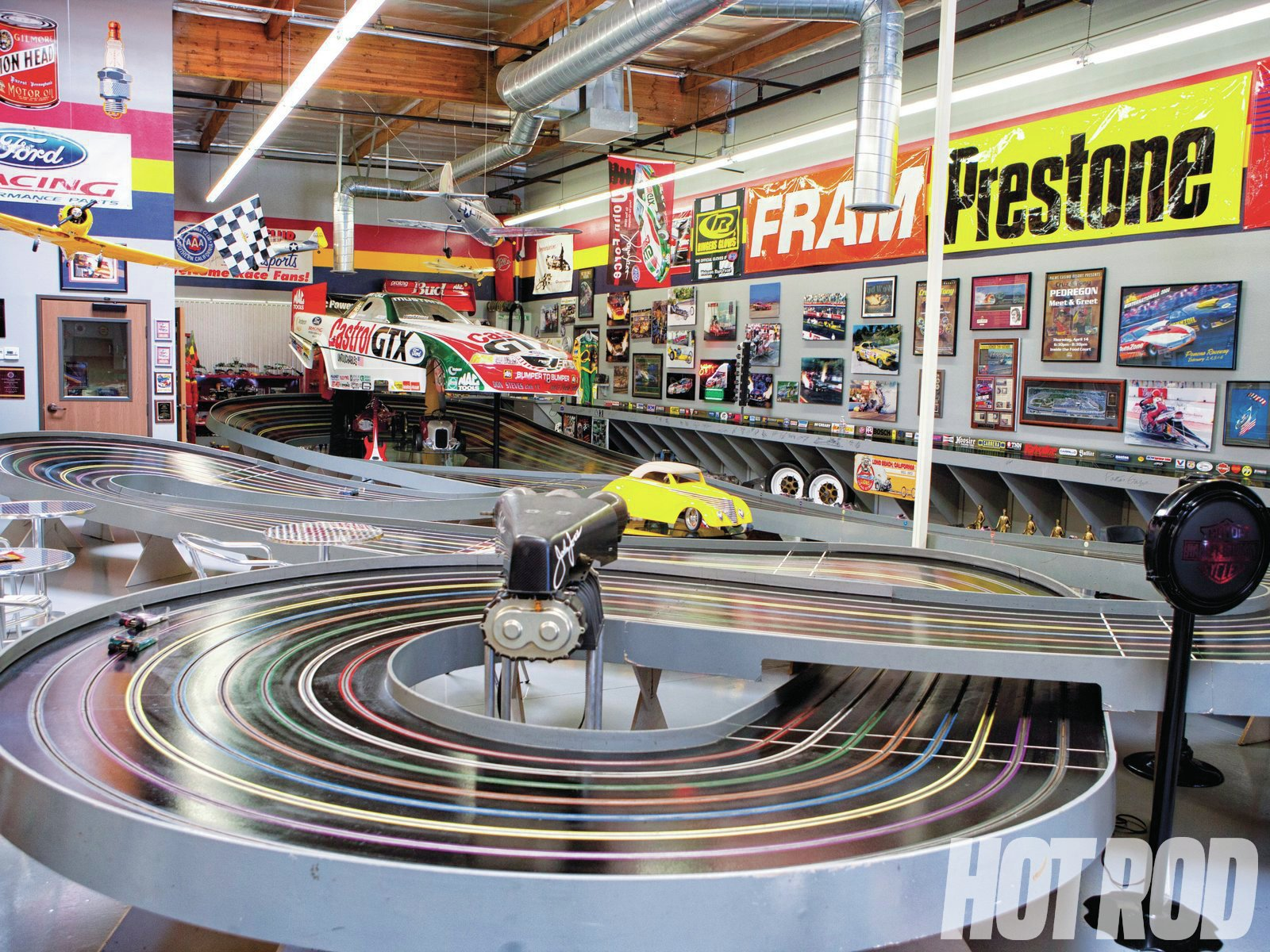 We would happily get rid of all our living-room furniture if we could replace it with this 155-foot Euro King slot-car track. Jim says the fast cars will make a lap in less than two seconds. The dragstrip in the back ain't bad, either.