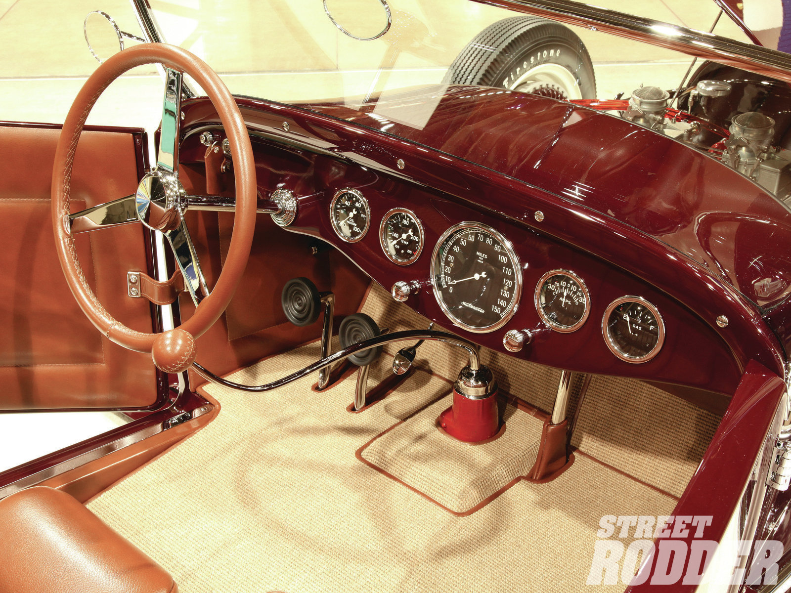 The original (restored) Stewart-Warner gauges positioning within the custom dash were determined by the steering column placement. While offset from what we might expect the gauge placement is both functional and appealing.