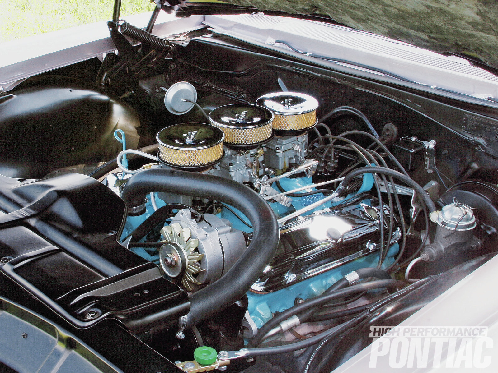The original 389 was treated to new soft plugs and gaskets before it was detailed and fitted with a correctly date-coded Tri-Power system, featuring an ultra-rare NOS center carb. The chrome valve covers were also added for a splash of brightwork under the hood.