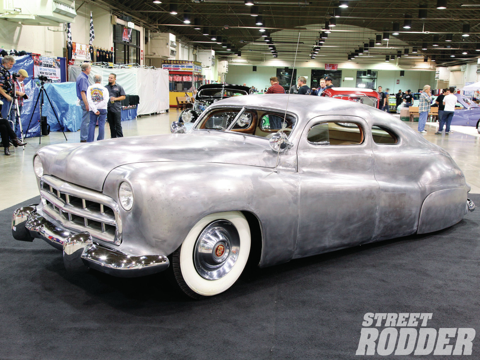 The Jack Stewart '41 Ford coupe was on display in bare metal. He purchased it in 1947 and then chopped the top and channeled the body the following year. Gil and Al Ayala rechopped the roof, added the fade-away front fenders, and the car was finished up by George Barris (after Bob Hirohata handcrafted a set of taillights for the car). It was sold, sold again in 1954, wrecked, sold (to a young Bob Drake in 1955), sold again in 2006, then sold again to its present owner Palle Johansen (who lives in Denmark), who is restoring the car to its 1951 appearance.