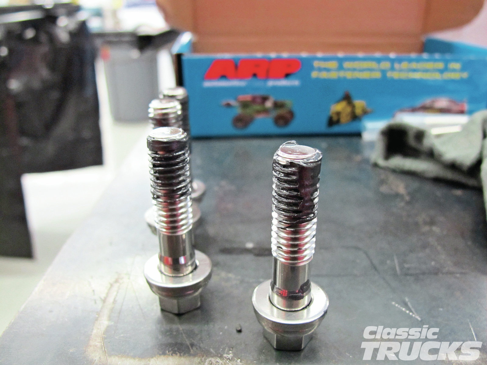 13. The bolts' threads were then covered with ARP Ultra Torque lube to help with torqueing the heads down. I also put a dab of Ultra Torque lube on the bottom of the bolt head and washer so that they would slide off one another and not cause a false bolt torque reading.