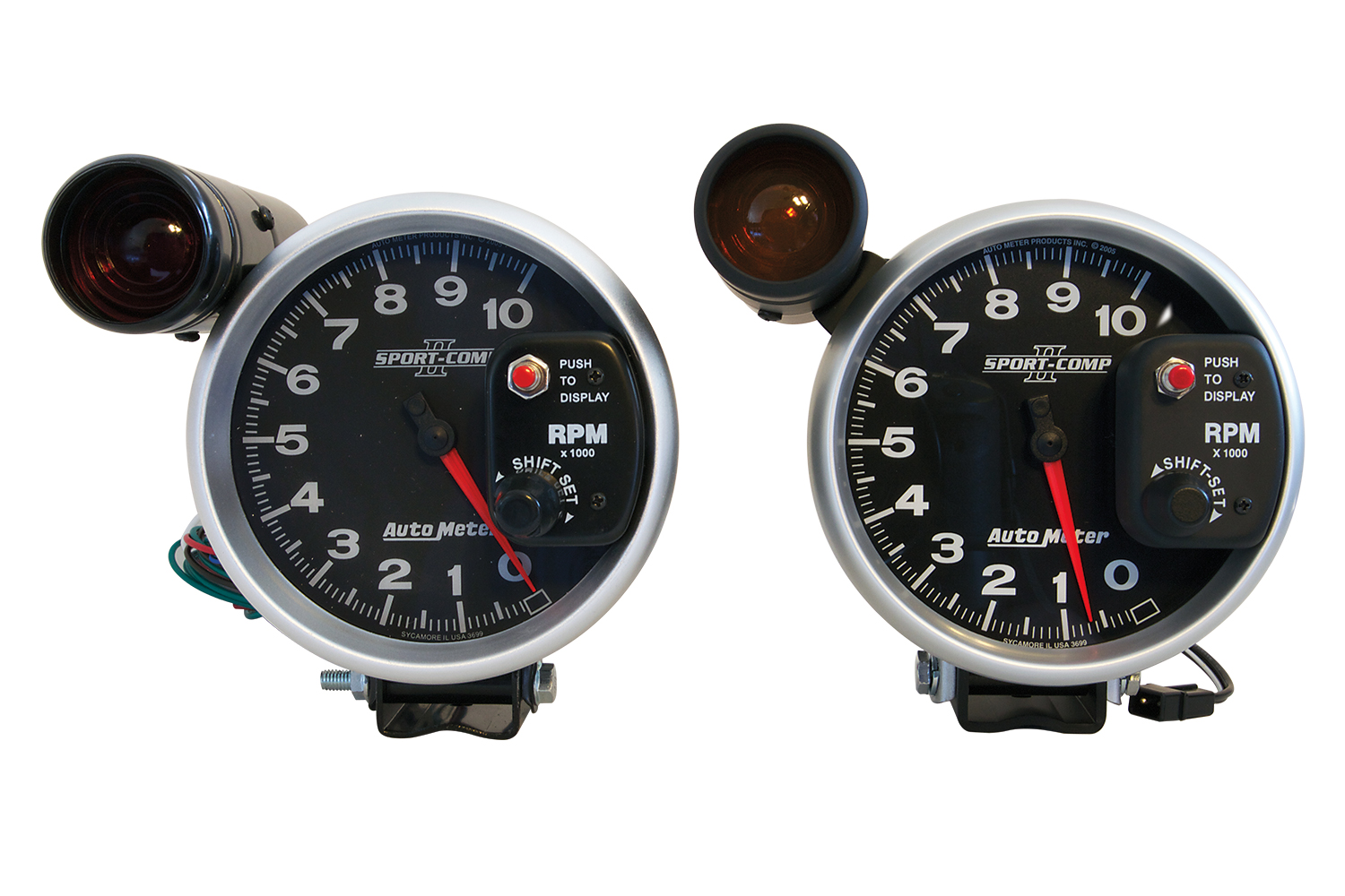 At first glance, there's little to distinguish between phony (left) and real (right) Auto Meter Sport-Comp II tachs.