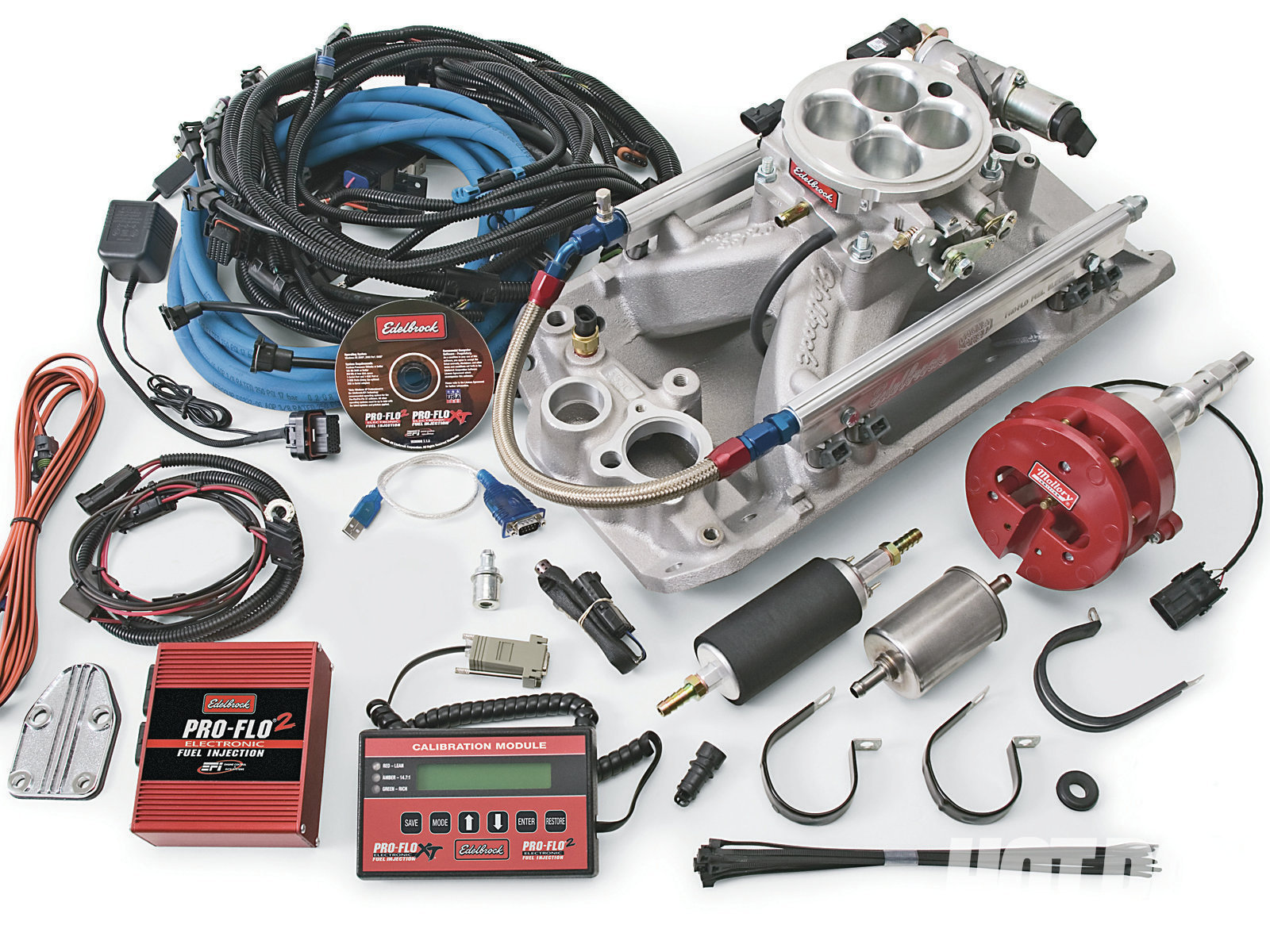 Edelbrock's Pro-Flo 2 AMC EFI system features fully sequential firing and is tunable via a laptop PC or by its unique handheld calibration module. Systems include everything needed for the conversion, including an intake and distributor. PN 35300 is for '69-and-earlier; PN 35310 fits '70–'91. They support up to 450 hp with their included 29-lb/hr injectors.