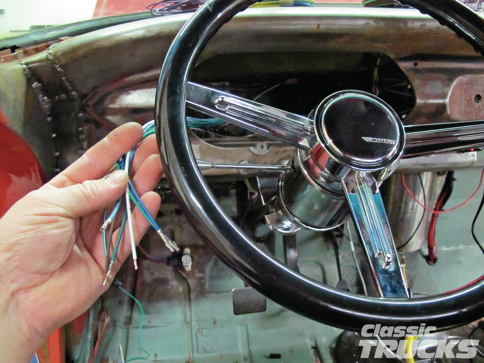 09. I removed the instrument cluster and ran all wire for the gauges through the hole. This way when wiring the instrument cluster I could have all the wires in a general location.