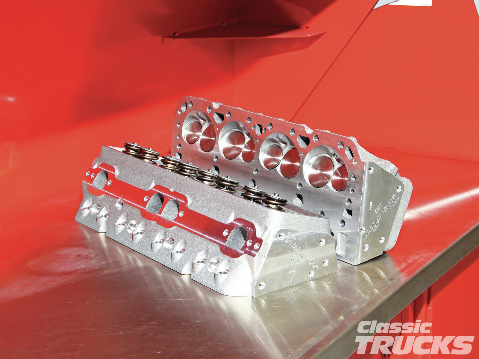 11. I used a set of aluminum Trick Flow heads (part number TFS-30400006) that helped increase the horsepower numbers and reduce the total engine weight. I ordered the Trick Flow heads from Summit Racing along with most of the other engine parts. The heads are 195cc intake runners with 62cc combustion chambers. Since we looked up the piston dish, around (-12cc) and the depth of the piston in the bore when at TDC (-0.032), I was then able to calculate what the compression ratio was roughly going to be by entering the numbers in a compression calculator I found online. I calculated the compression right at 9.6:1 with a 62cc head and a 0.015 Fel-Pro head gasket.