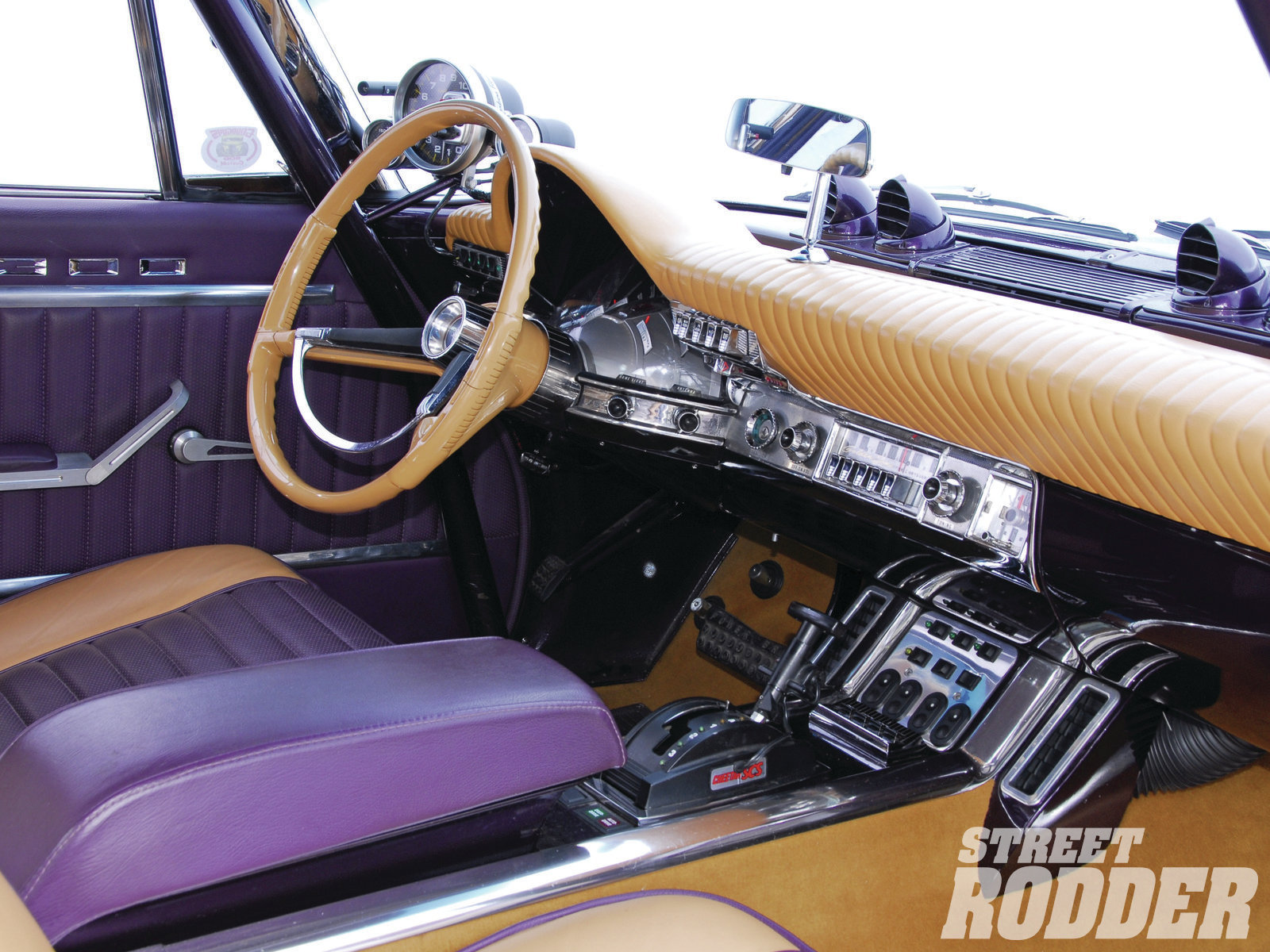 The stock dash was retained and the original gauges were restored as was the factory steering wheel. Vintage Air keeps it cool while AccuAir sets the level and a Cheetah SCS shifter makes for fast getaways.