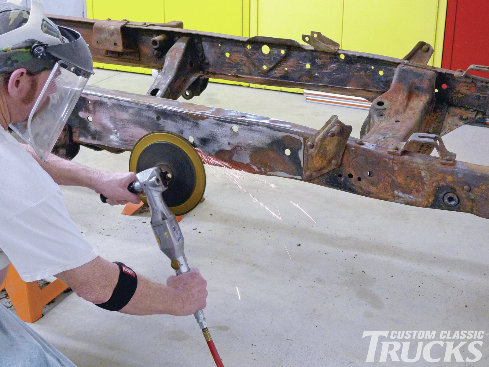 3. Although we're now satisfied that these twice-repaired 'rails are true in trajectory, they're not without witness marks. Here a worn 3M body disc on a Harbor Freight, Central Pneumatic buffer/grinder works as a highlighter of sorts. The large dark areas are low, and they won't disappear after powdercoating.