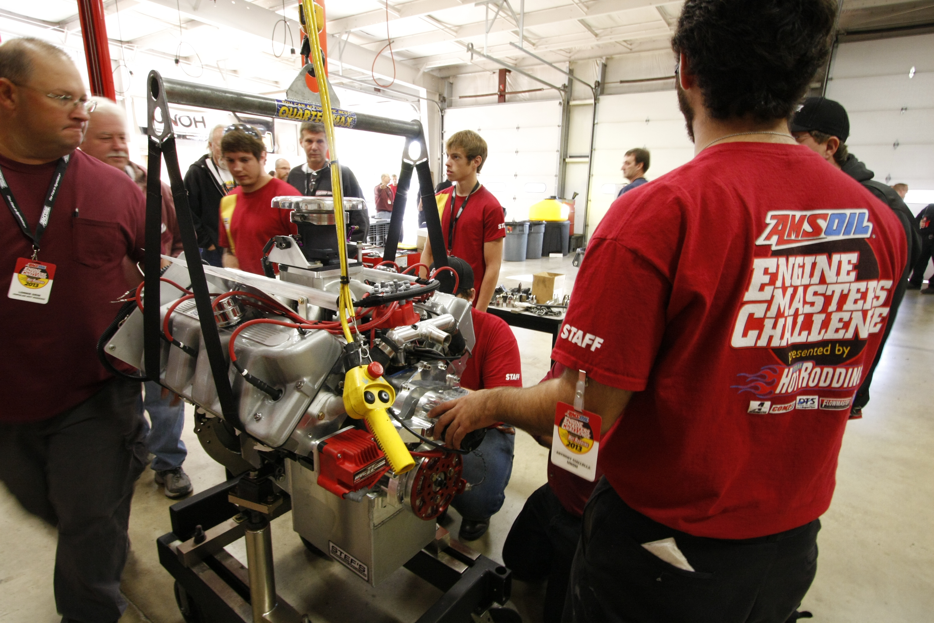 UNOH unloading area, students mounting the 409ci Boss 429 from team Almost Kaase onto the SuperFlow/DTS Dyno cart