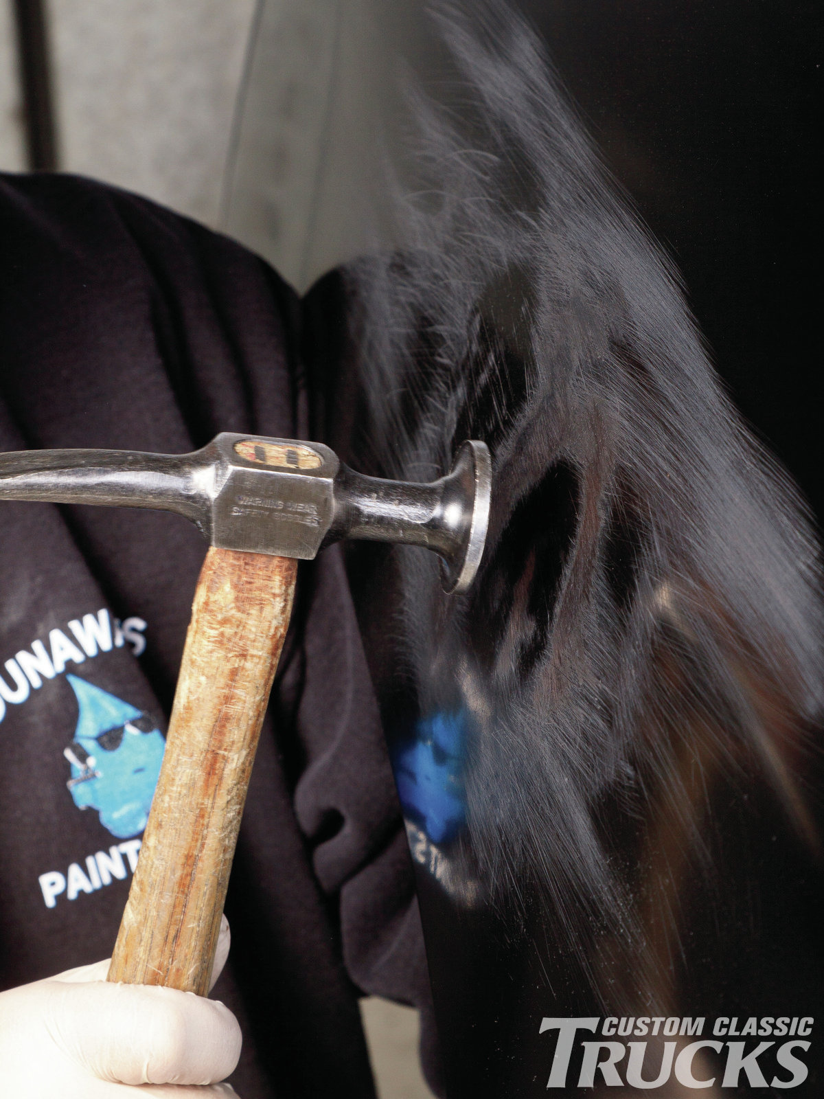 15. A traditional curved cross chisel body hammer is now used, backed by a toe dolly to massage the remaining low spots.