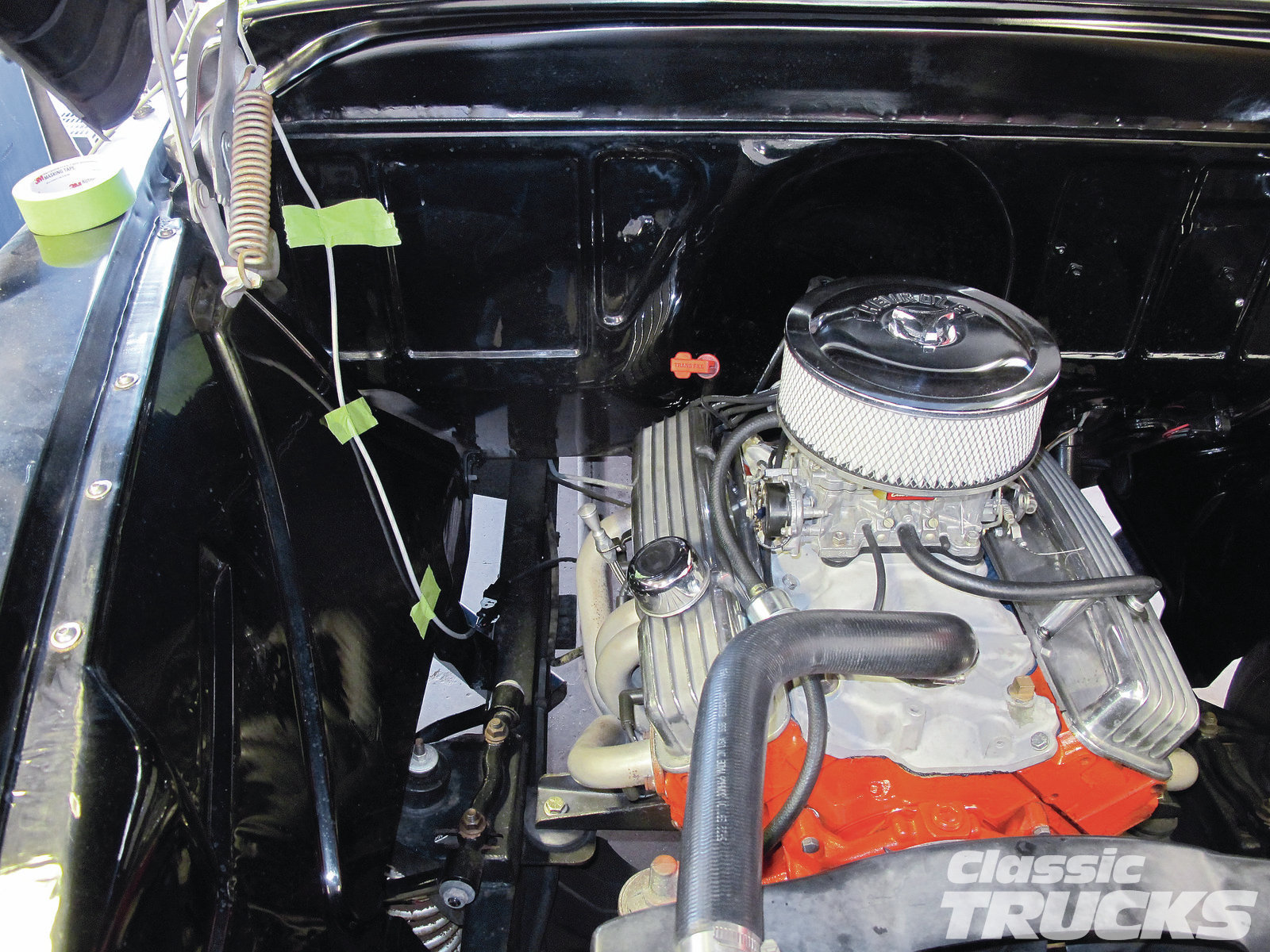 Since we were using this to tune several vehicles we wanted the wiring and O2 sensor to be removable. Using green tape I routed the wiring through the hood and into the cab. To power the FAST O2 sensor reader, simply plug it into a cigarette lighter socket and push the power-on button.