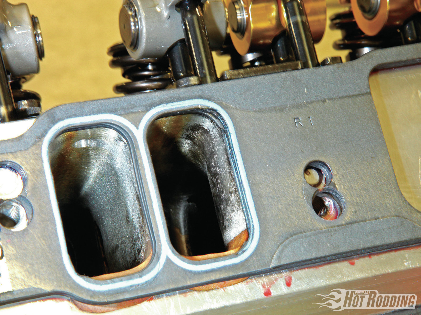 A set of Fel-Pro gaskets illustrate the radically raised port position. Note the re-punched fastener location and the altered port floor.