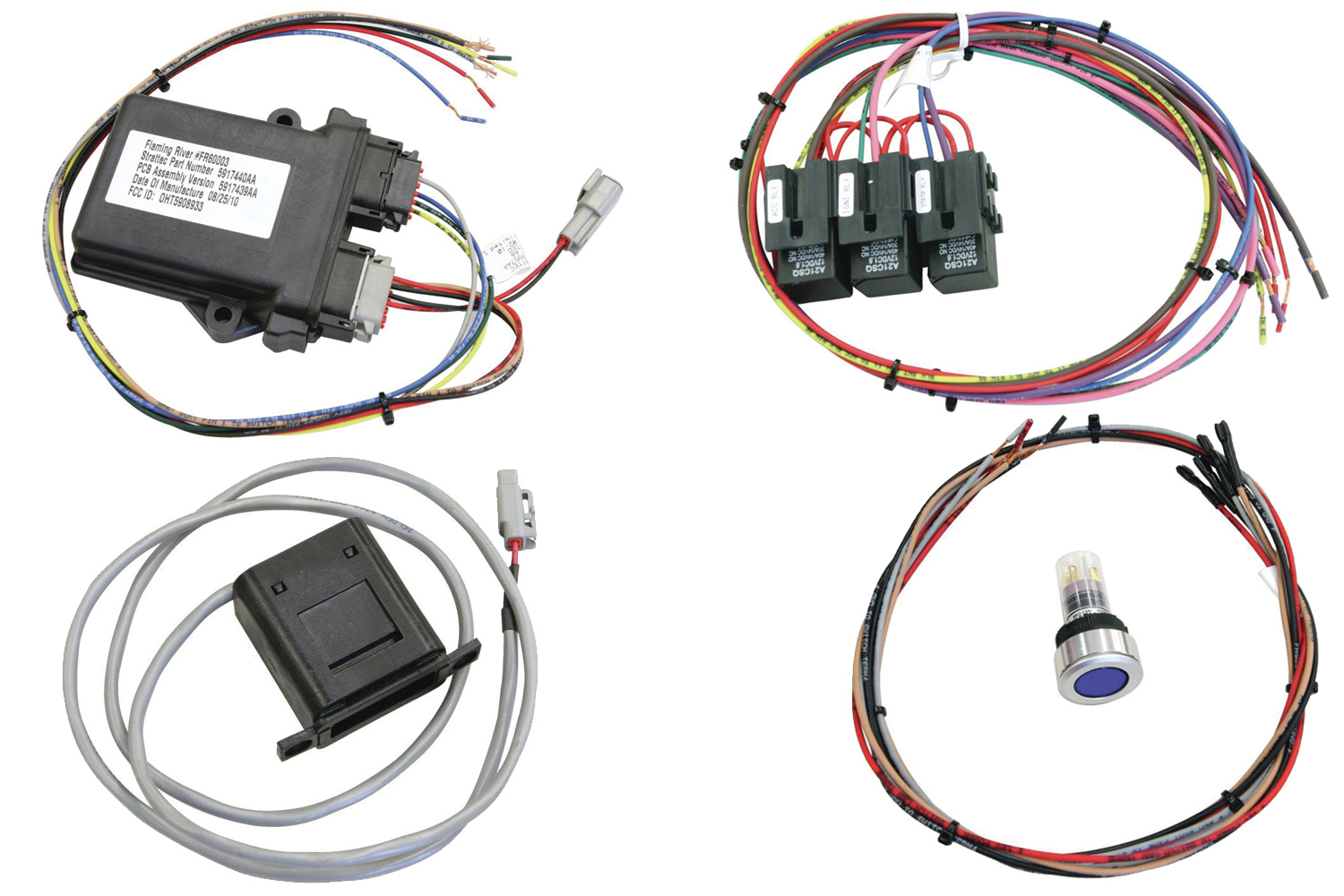 1-4. Flaming River offers a few different push-button start kits with a variety of different functions. We're using the keyless ignition kit that incorporates an in-dash docking station and keyless entry. The kit consists of a near reader module, a relay harness, docking station, push-button switch, and remote keyless entry system. The near reader module is the brain behind the system, communicating between the push-button switch and the respective functions (start, accessory, etc.) via the relay harness, which protects the switch and module so that they don't bear the brunt of the electrical load.