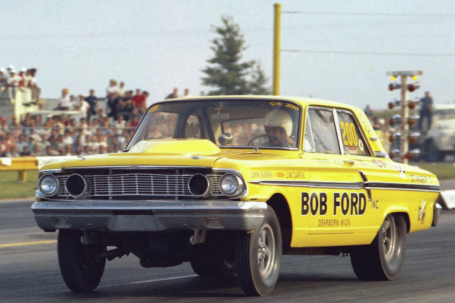 """What if we took the Fairlane body and put the 427 eight-barrel engine in it? Would that work? In 1964, Ford created the Fairlane Thunderbolt specifically for drag racing dominance, 3 inches shorter and 700 pounds lighter than the Galaxie, and handed out about 100 of them over the next two years to some of its best racers. The cars were all built off-site at Dearborn Steel & Tube, aka DST or """"The Tube"""" in Ford-speak. This car, raced by driver Kenny Vogt for local Dearborn dealer Bob Ford, is shown at the NHRA Indy Nationals in 1964 in C/Altered, because NHRA still hadn't figured out where the factory supercars belonged."""