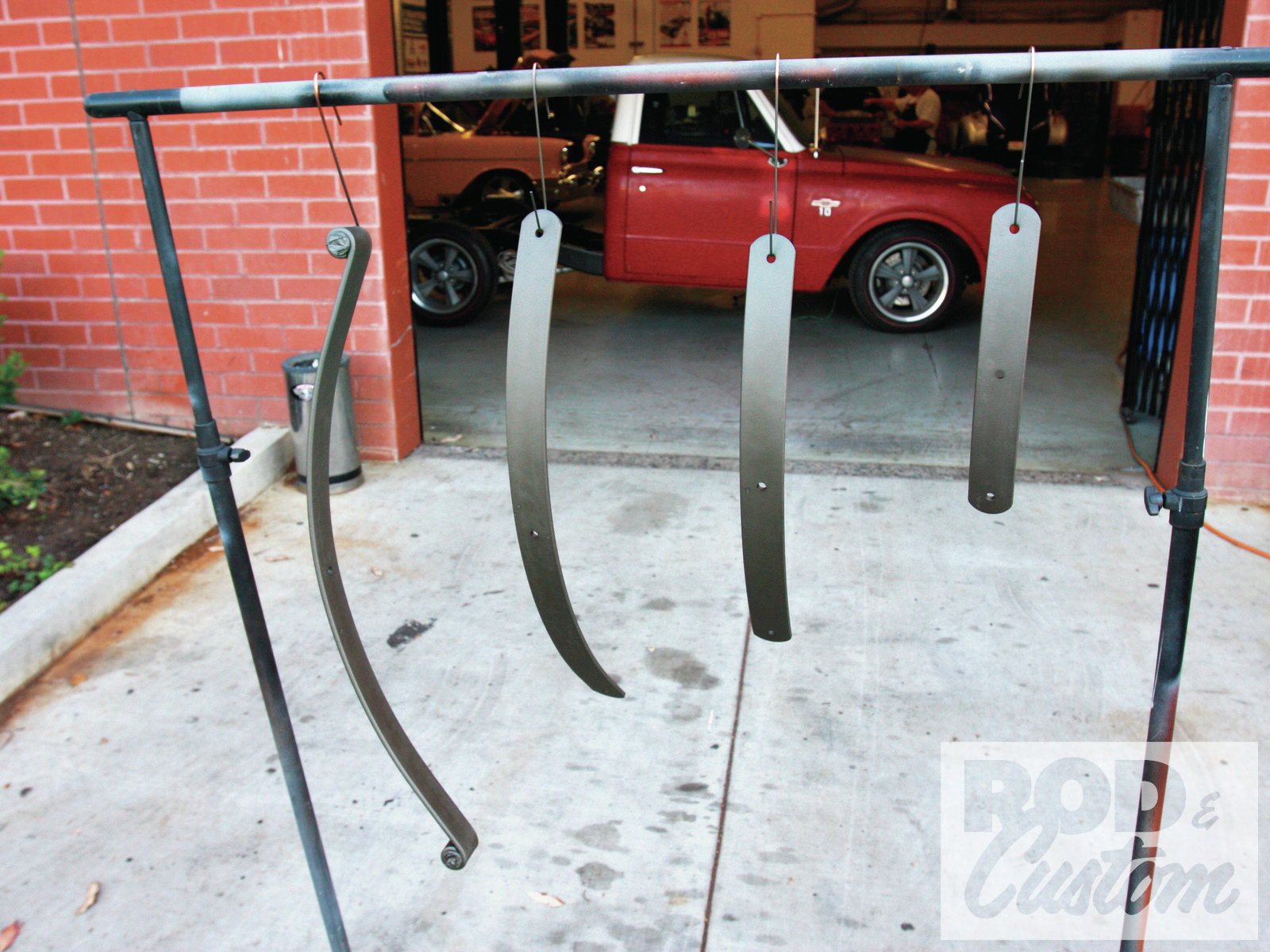 9. Here's our front spring, the leaves separated for painting. This will ensure no unsightly rusty water trails from between the leaves after assembly. Details, details …