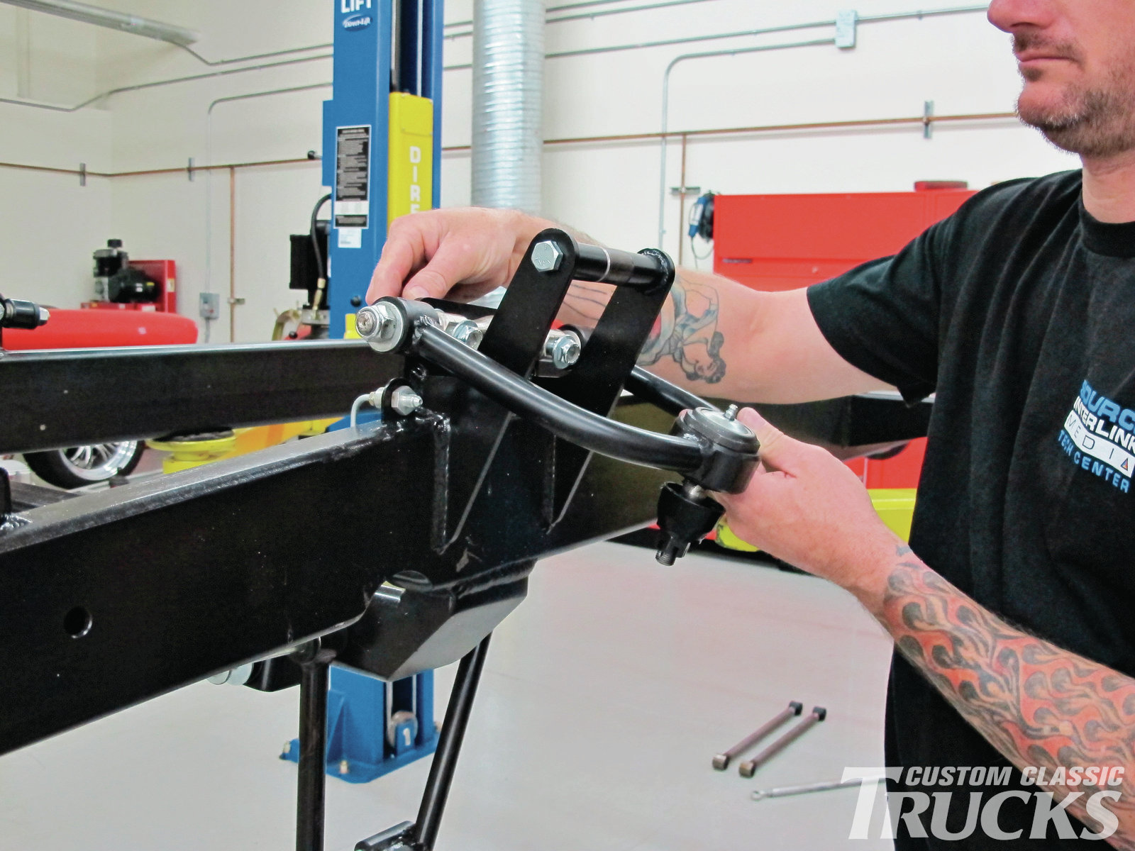 7. To ensure the front suspension stays in alignment, the upper A-arms attach to vertical plates. This allows the use of shims for caster and camber adjustments rather than the slots and sliding bolts often seen.