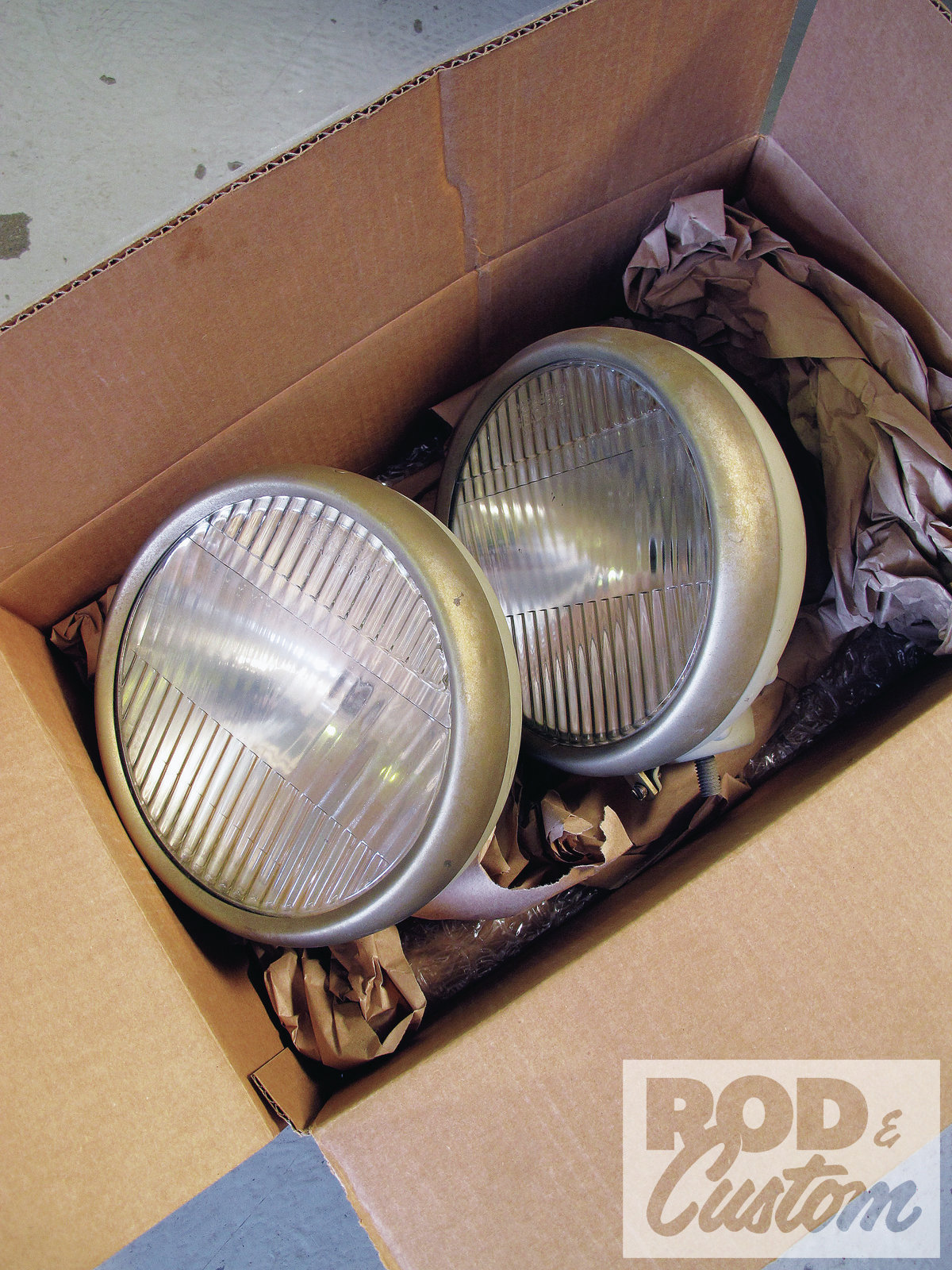 "3. For the headlights, I scored these Parabeams a couple years back in Columbus. They're somewhat similar to a stock '33-34 light, but with subtle enough differences (like the shape of the bucket, for one). However, there is a drawback—the ""ball"" portion of the mount is reversed, so I'll be swapping that out down the road once I locate a set of donor buckets."