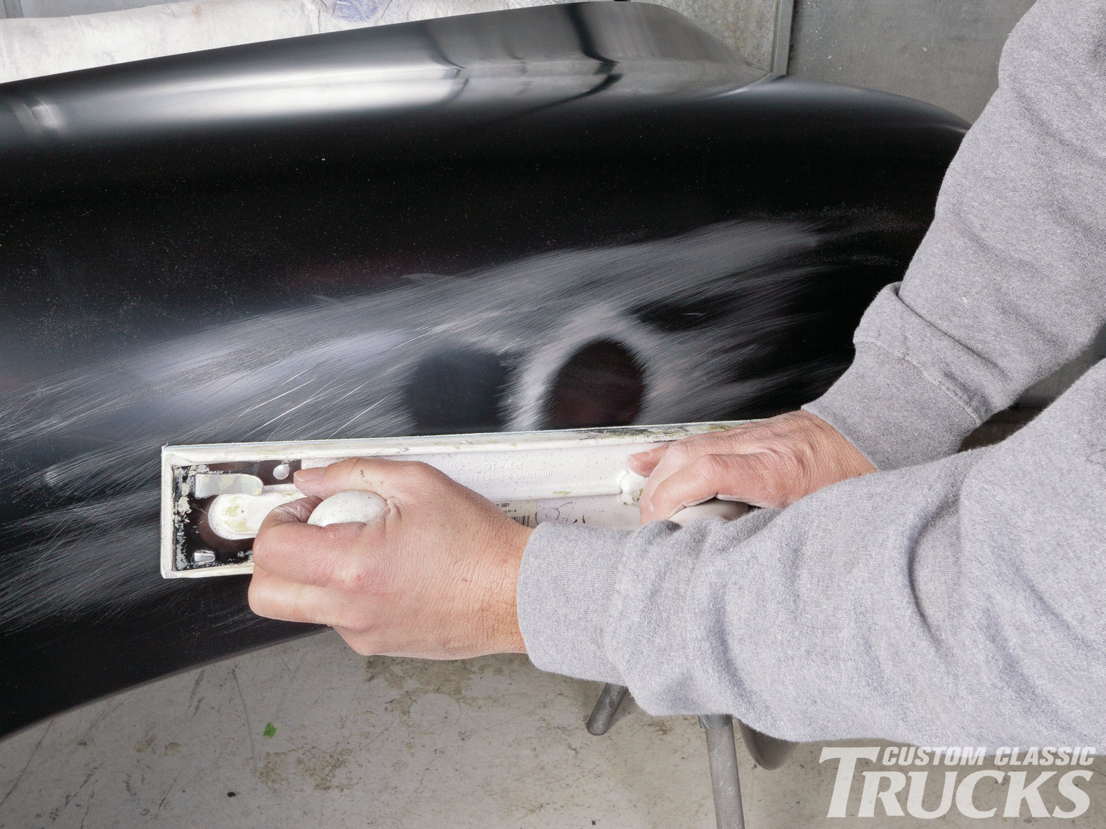 4. The first step in repairing any dent is to reveal the high and low spots on the panel. To do this, a fixed body file is used to skim the damaged area. The high spots are scuffed as the file is drug over the surface while the low spots remain unaffected.