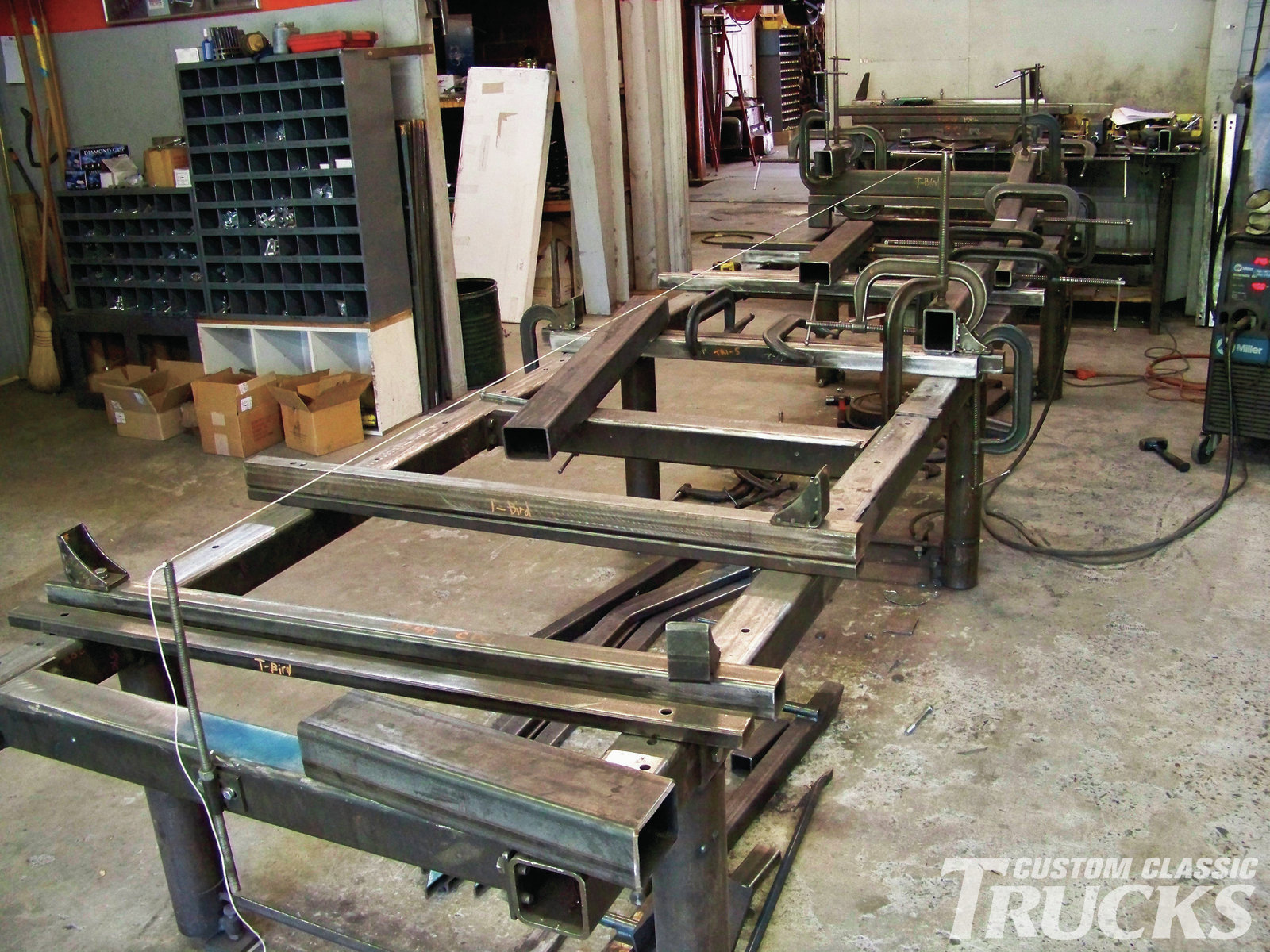 2. This jig is used for truck frame assembly. Specific stops are bolted in place to ensure proper alignment for welding.A center string line is used as a double check to be certain the frame remains square and true as welding takes place.