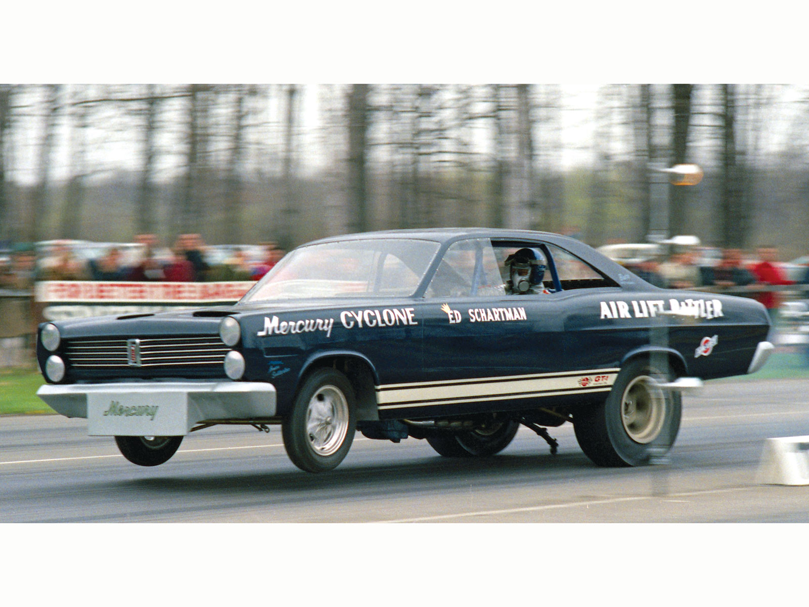 The beautifully simple paintjob on Eddie Schartman's Mercury Comet Air Lift Rattler, shown here in action at the Super Stock Nationals at New York National Speedway in 1967, covered an extremely competitive car and driver. Schartman stuck with the Mercury Funny Car racing program right on through the switch to Cougar bodies, right up until the end of Ford racing in 1972, eventually adapting a blown Cammer motor as Chrisman and Nicholson had done.