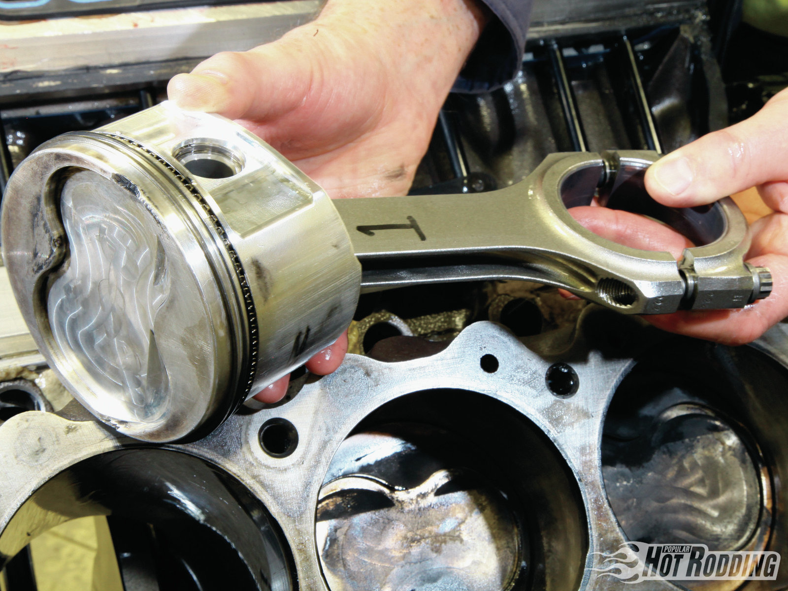 Filling the bores are a set of JE forged pistons hanging from Scat H-beam rods. The pistons were modified by engine builder Mike Semchee with a dish matching the combustion chambers. The effect of the volumes involved tally to a pump-gas friendly compression ratio of 10.4:1.