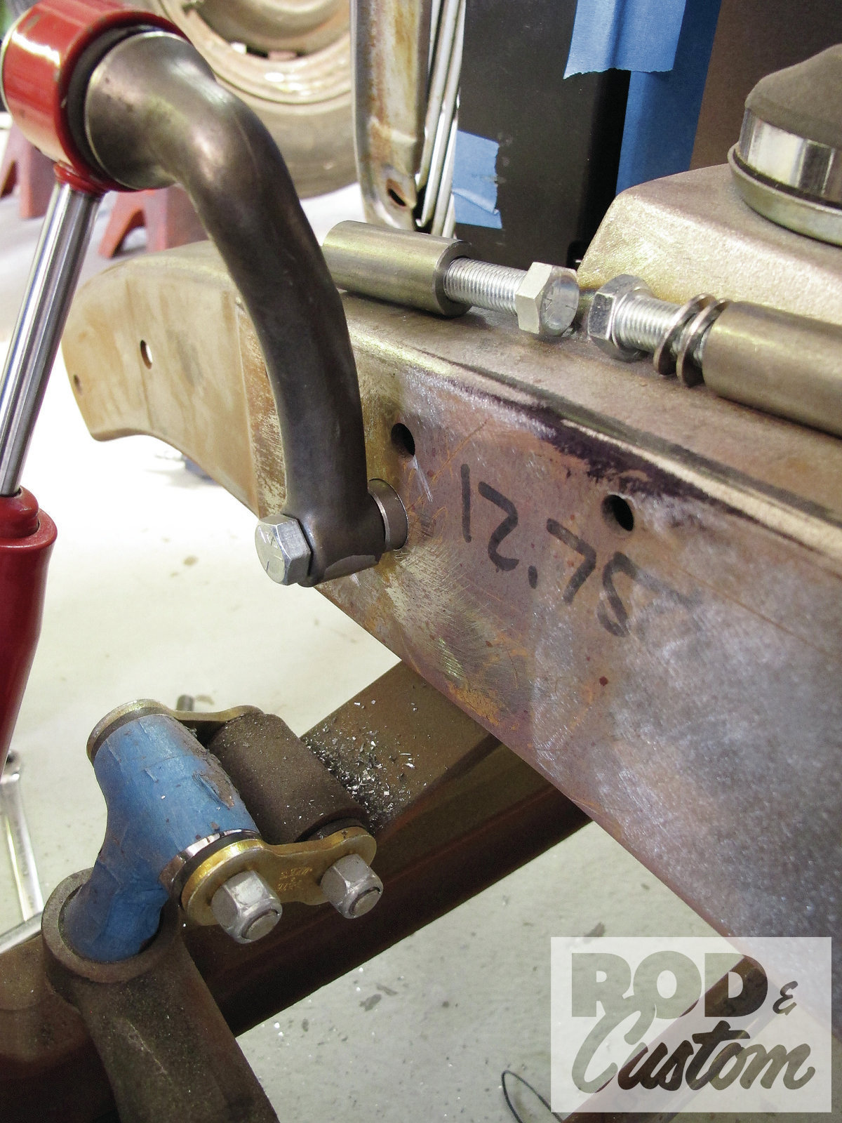 9. Starting with a pilot guide, White followed by using a Rotobroach with a pneumatic drill. The upper bung only requires drilling one hole; however, we may copy the lower later on by swapping for a longer bung that gets welded on both sides of the framerail.