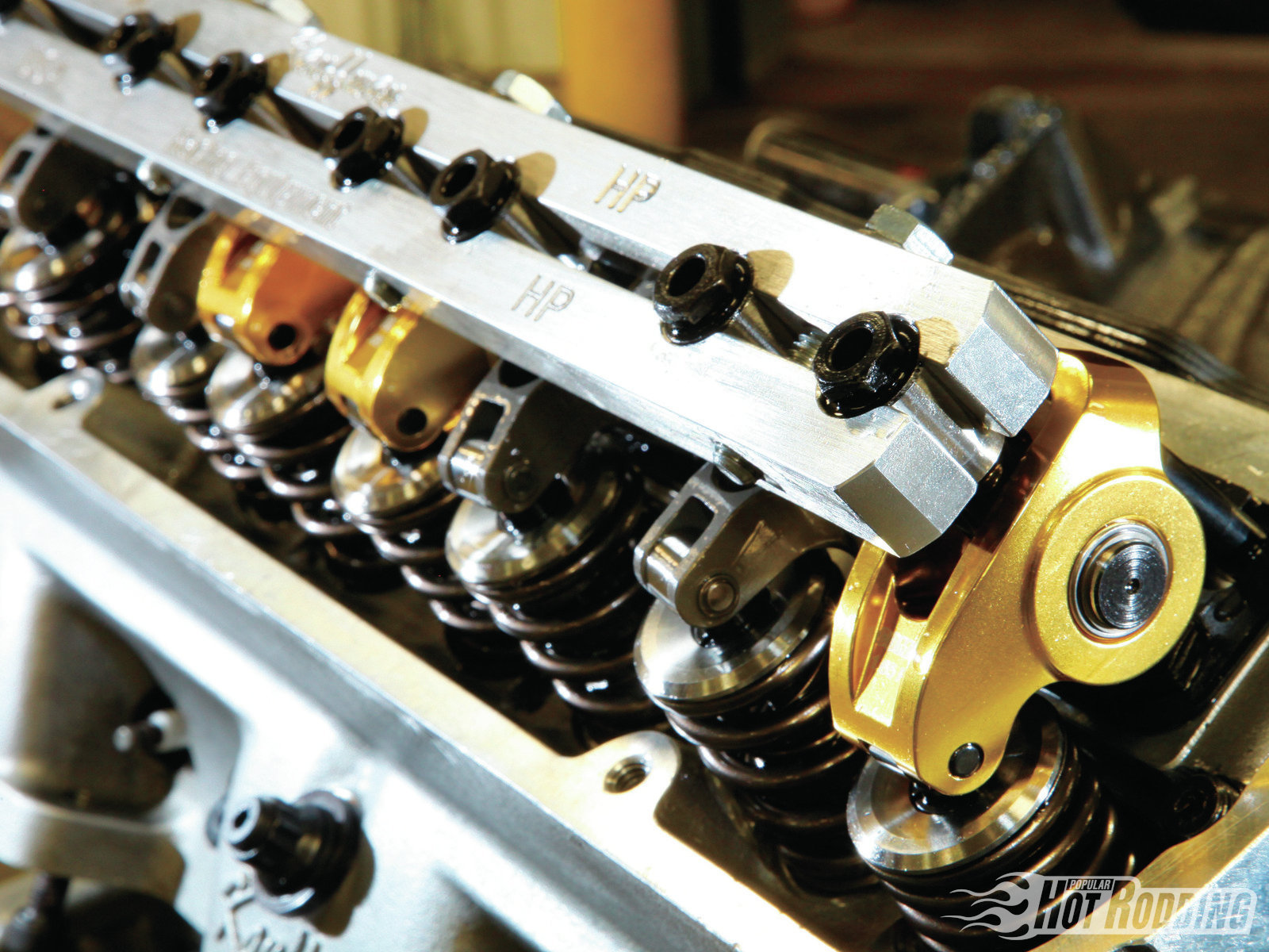 The stud-mounted valvetrain features both COMP and Crower rockers, as testing showed a slightly reduced ratio on the exhaust side improved power. The intake ratio specs at 1.7:1, while the exhaust is 1.65:1. The Kauffman stud girdle ties the valvetrain together for improved stability.