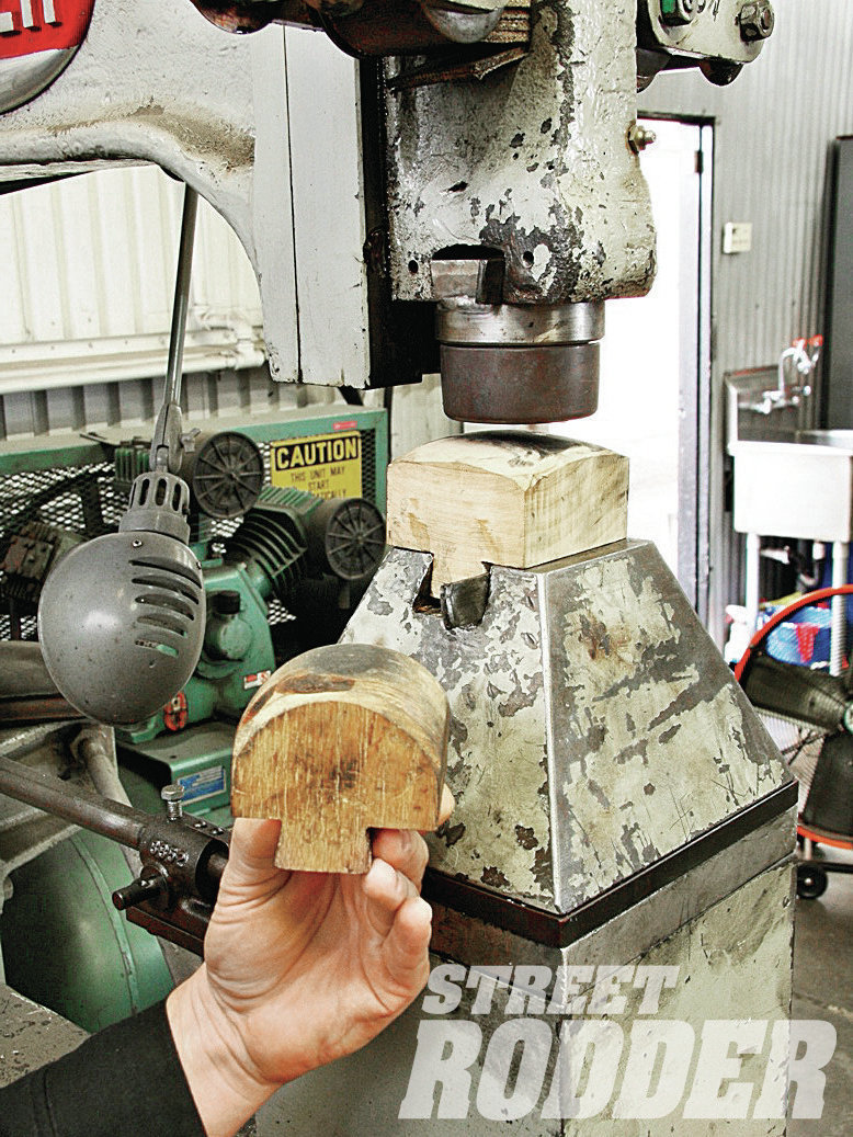 To do the forming of the quarter-panel on Walden's Yoder powerhammer (but not shrink or stretch the metal), wood-forming blocks were made to work with a rubber upper die.