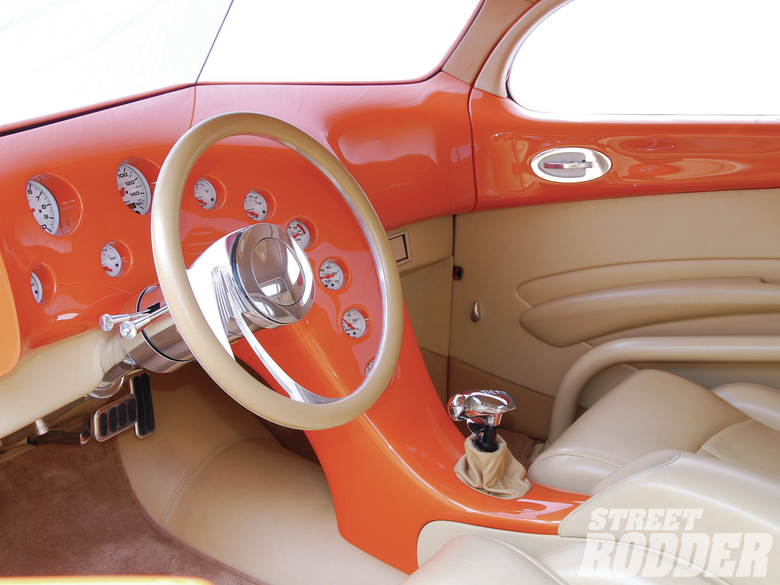 To bring plenty of class into the business office, Dean Alexander at The Hot Rod Garage created a flowing dash and console adorned with plenty of smooth tan leather accented by German square-weave carpeting. Auto Meter gauges and a B&M shifter keep it all real.