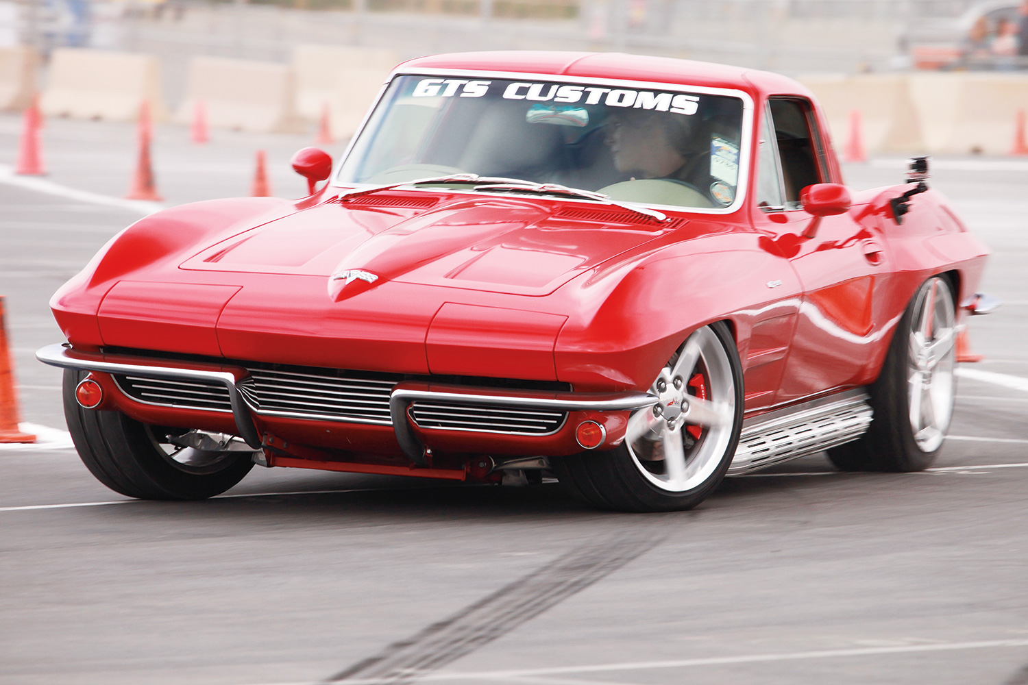 We spent some time hanging out with Greg and Jane Thurmond, who own this highly updated '64 Corvette. They are serious autocrossers and muscle car fans—and the C4 suspension, LS6, and T56 transmission in their beautiful midyear proves it. Piloted by Greg, it took the overall win in Street Machine with a 54.086-second lap.