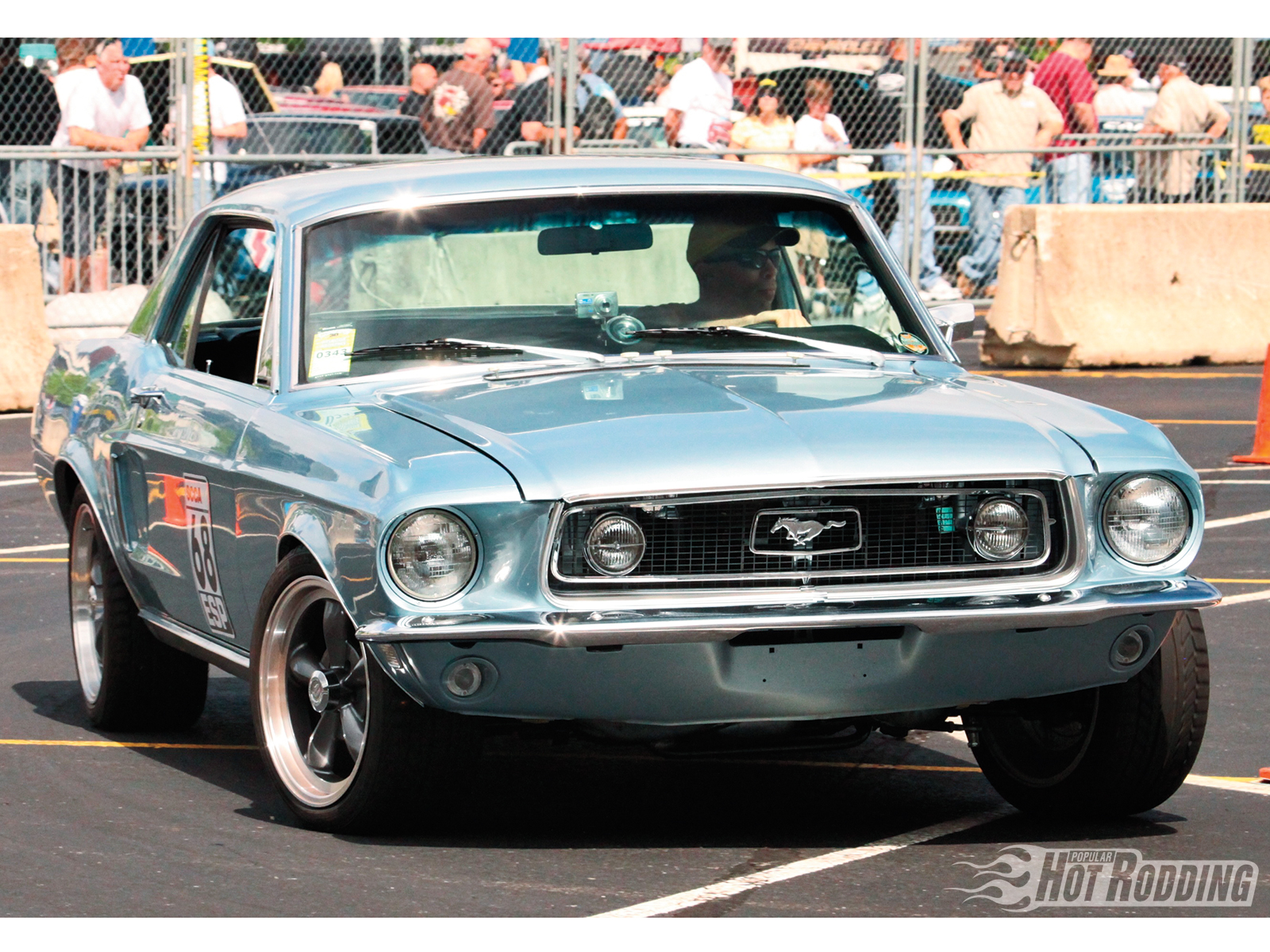 Our faith in Fords was further bolstered in Nashville by Mark Strong's 1968 Mustang coupe, looking eerily like Christopher Campbell's similar machine. Strong calls on suspension parts from Global West to get him turned, while go-power comes from a stock 302, and braking via SSBC discs.