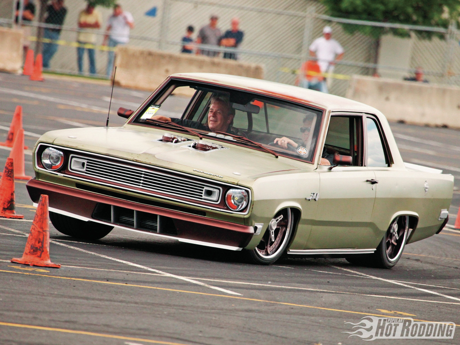 """Jesse Greening built this 1969 Plymouth Valiant for customer Don Montgomery, and it had us foaming at the mouth. Greening left the Valiant's perfect green survivor patina untouched, and built a masterpiece around it, even color-matching the surface rust spots for the bumpers, trim, and wheels. Stay tuned for more details on this """"Pissed Off"""" one!"""