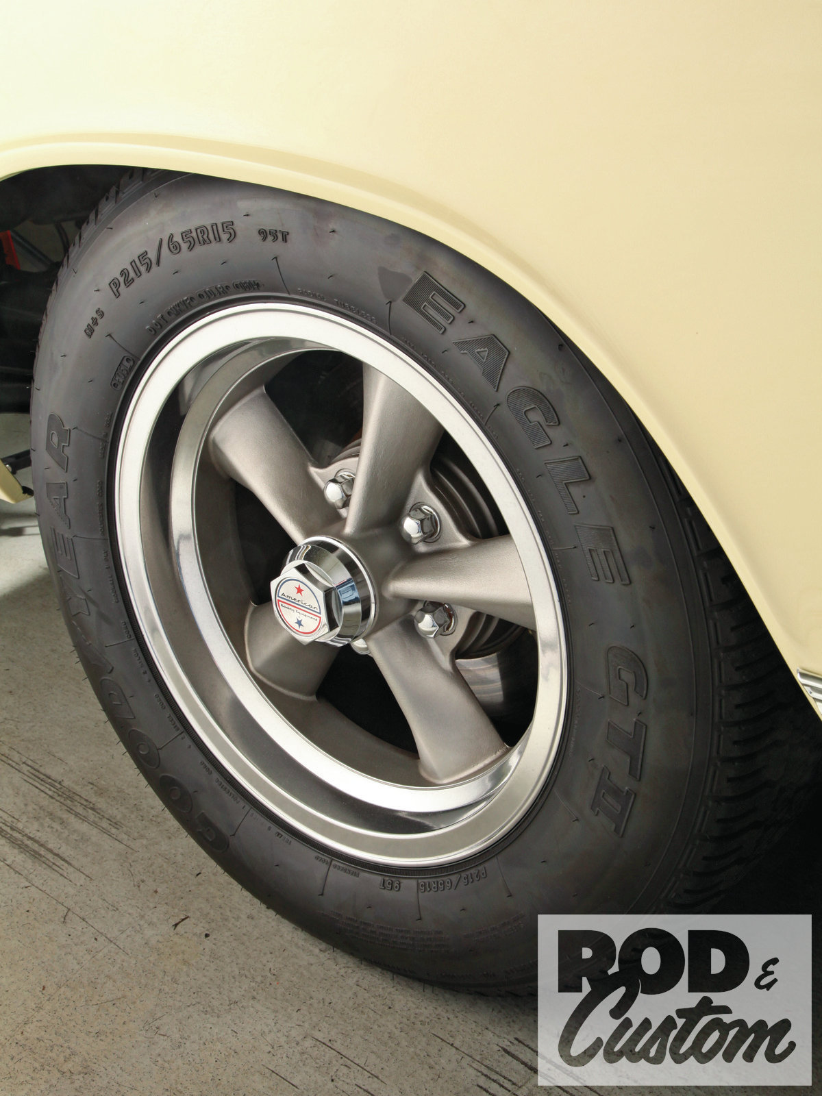 The Torq-Thrust R wheel came out in 1969. It features straight, highly peaked spokes and a snap-in center cap. The T70 wheel that American introduced the following year (and reissued recently) resembles it but has a perimeter flange around each spoke.