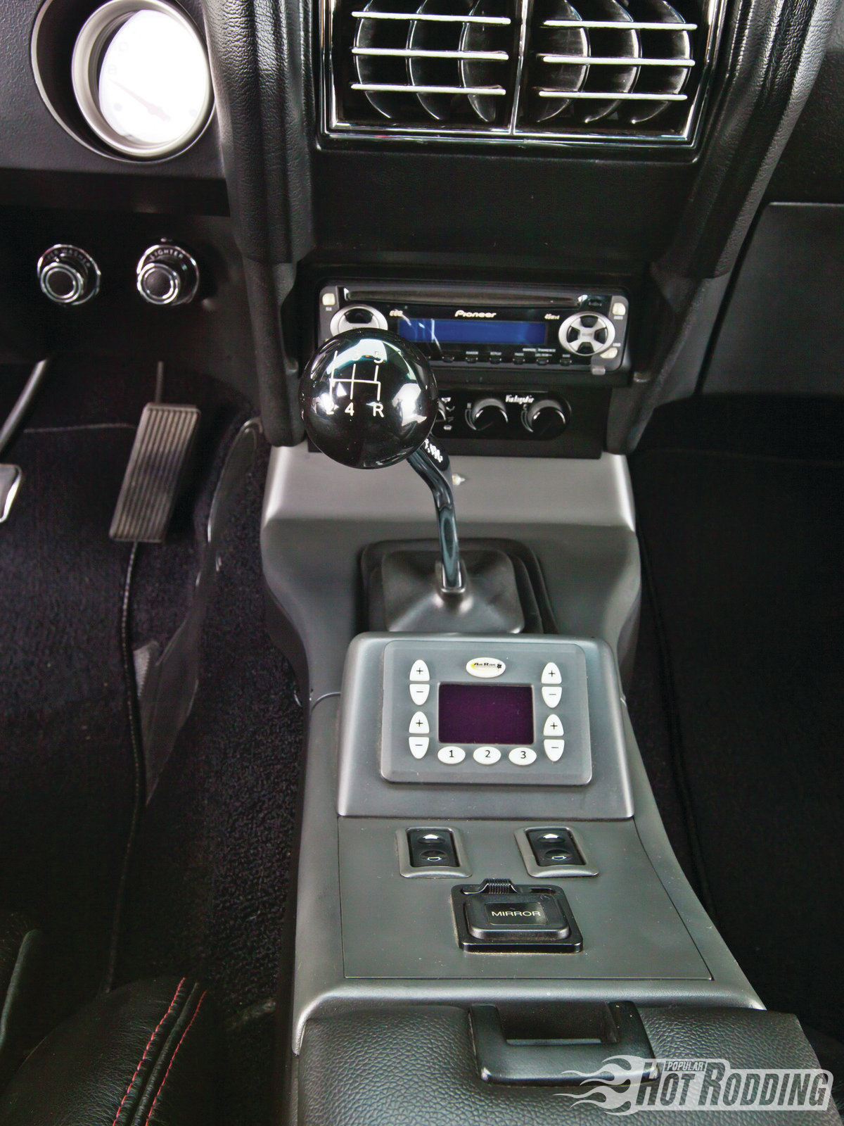 The scavenged center console houses the RideTech digital control, Vintage Air Control, power window switches, and power mirror switches. Guy used Acura mirror servos and LEDs in the original mirror housing to create power mirrors with integrated turn signals.