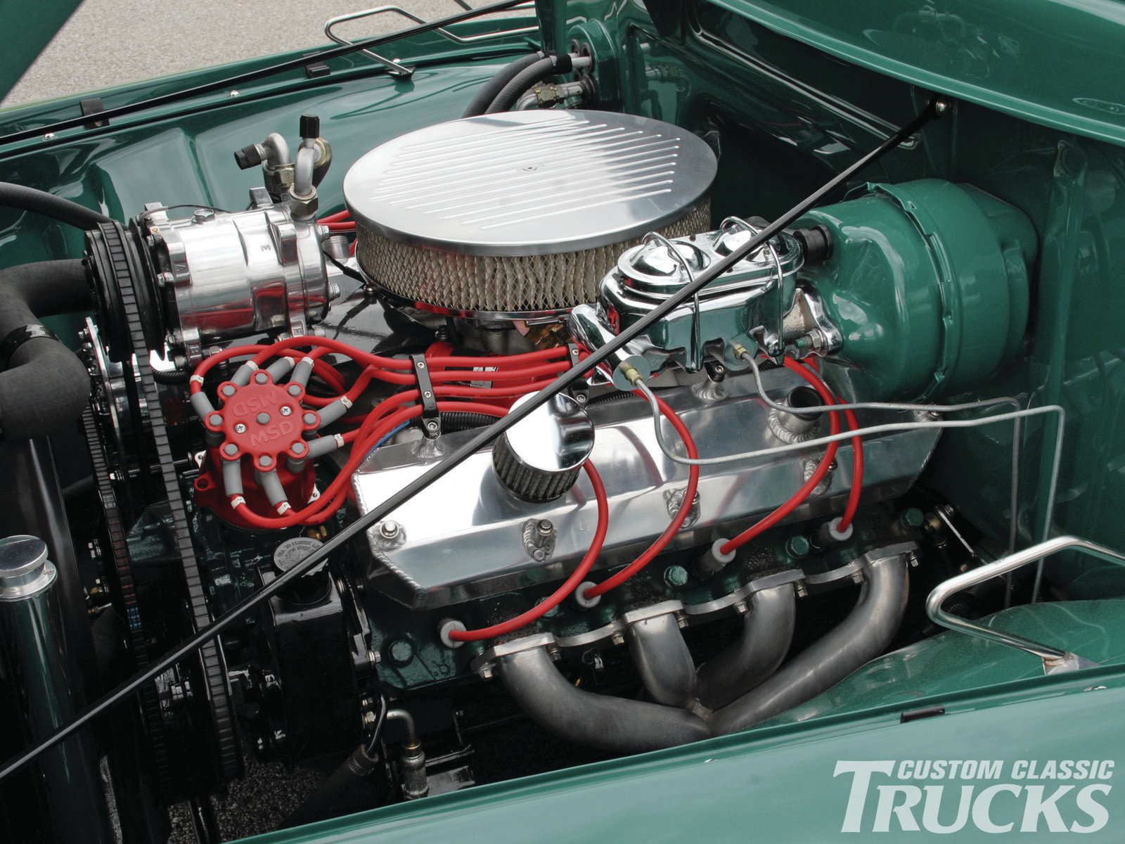 What could be more traditional than a Cadillac motor in a hot rod truck? This is a '76 Caddy that displaces 500 cubic inches. Edelbrock intake, Keith Black pistons, and reworked heads make this Potter Automotive motor good for 400 ponies.