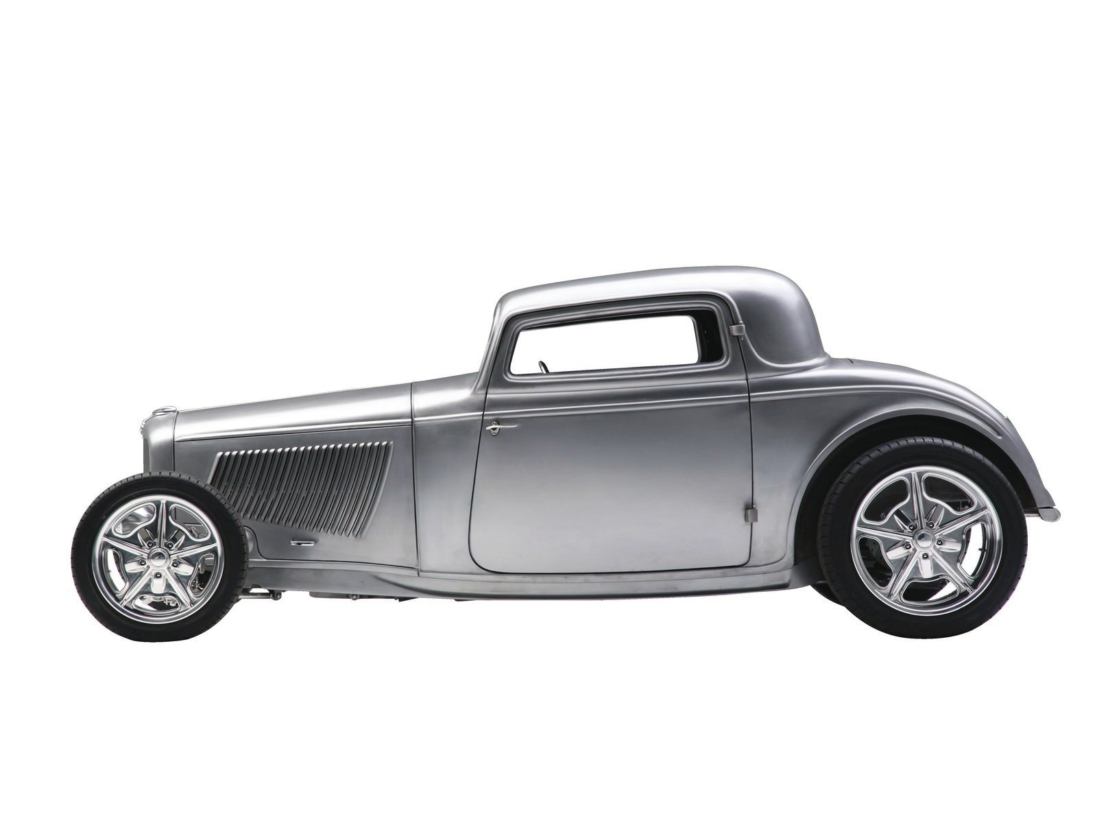 23| It's high tech (big-inch billet wheels, IFS/IRS, an LS3 under the hood), but also traditional in many ways (hood louvers, exposed hinges, and door handles). Some say it would be a shame to paint it, but gloss might just be the cherry on the sundae—we'll have to wait and see how it turns out!