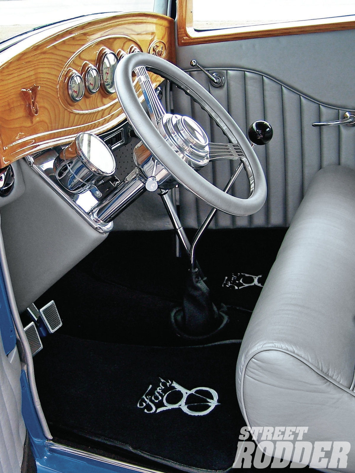 Charles Powell stitched the interior in Bill's ride with silver Ultraleather, and Bill's neighbor used a router to create the dash (made from ash). Bill took his time with the car's wiring and used a Painless Wiring kit, doing the work himself.