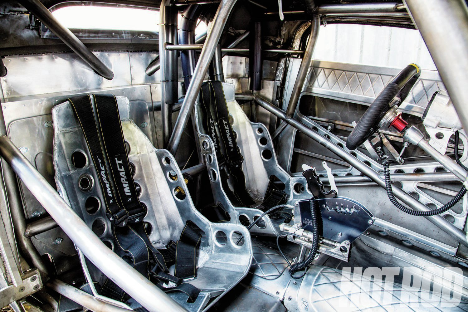 A chrome-moly rollcage gets the car certified to 7.50 seconds for drag racing. The aluminum bomber seats were created by Eddie's Chop Shop, as was pretty much everything you see in this shot.