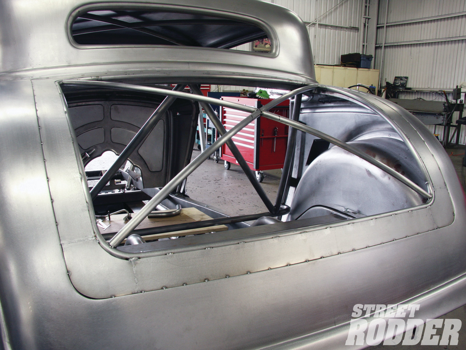 5| Similar to the way Ferrari doors and decklids were made in the '50s, an inner tubing structure was formed for Warren's decklid, to which an out flange (about 3 inches wide) was added. After the decklid's skin is rolled out, the edge of the skin will fold over the outside edge of the flange, securing it in place. The inner structure will remain as well.