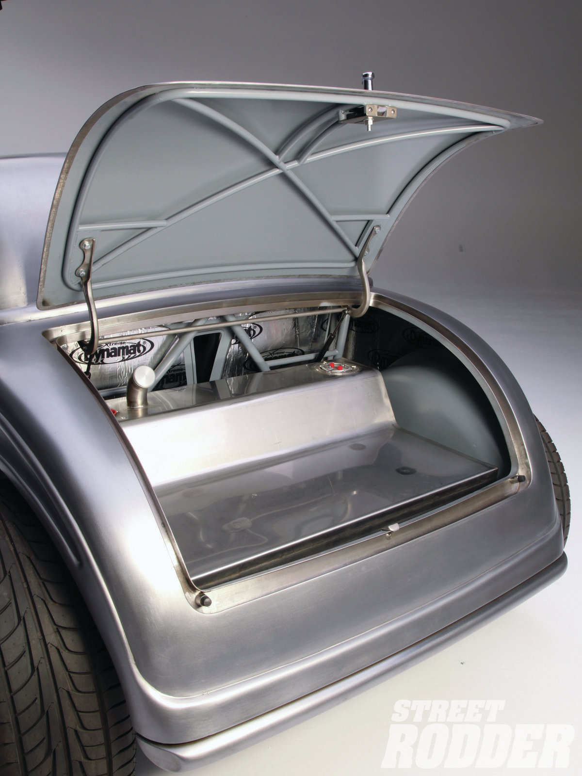 20| The tubular structure under the decklid will remain exposed even after the car is painted. Walden made a wooden buck to create the shape for the fuel cell, which is made out of stainless steel.