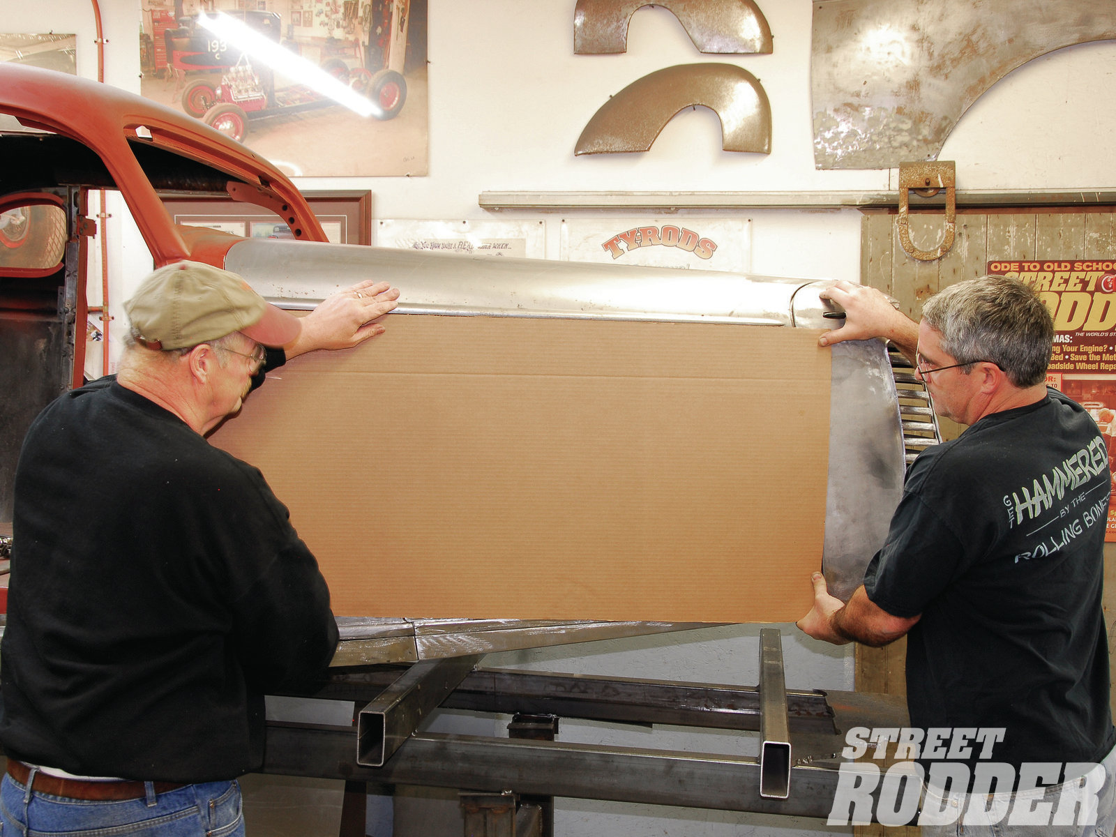 1| Rolling Bones team members Ken Schmidt (left) and Keith Cornell (right) hold a rectangular section of cardboard in place. This will act as an initial hood side template.