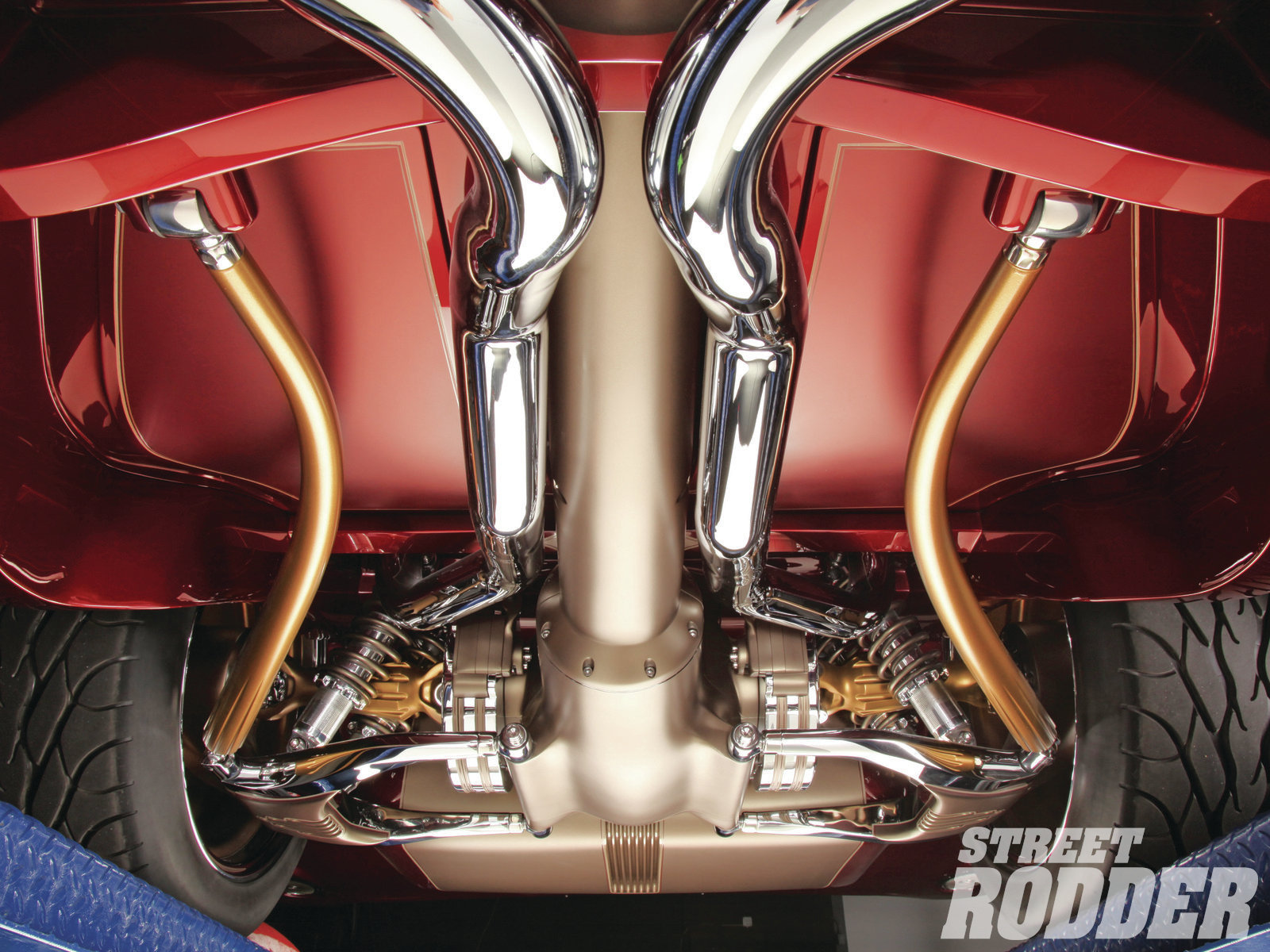 The lower control arms were first machined then curved before being fit to the car. A faux torque-tube was machined from aluminum by CAL Automotive, and the driveshaft is found inside.