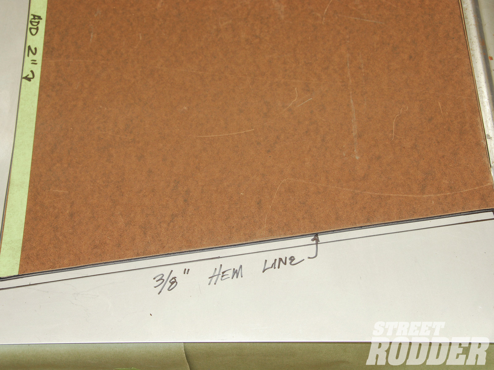 16| Here you can see the notation for adding an additional 3/8 inch for a hem line to the front of the hood side.