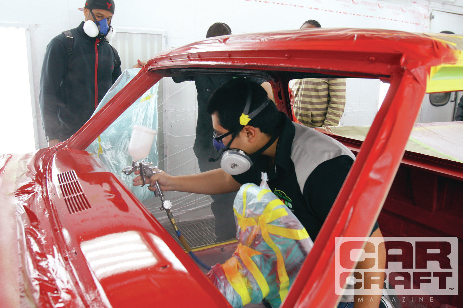 [16] After the clearcoat cured, we remasked the car to paint the interior. The students each took a turn with the paint gun.