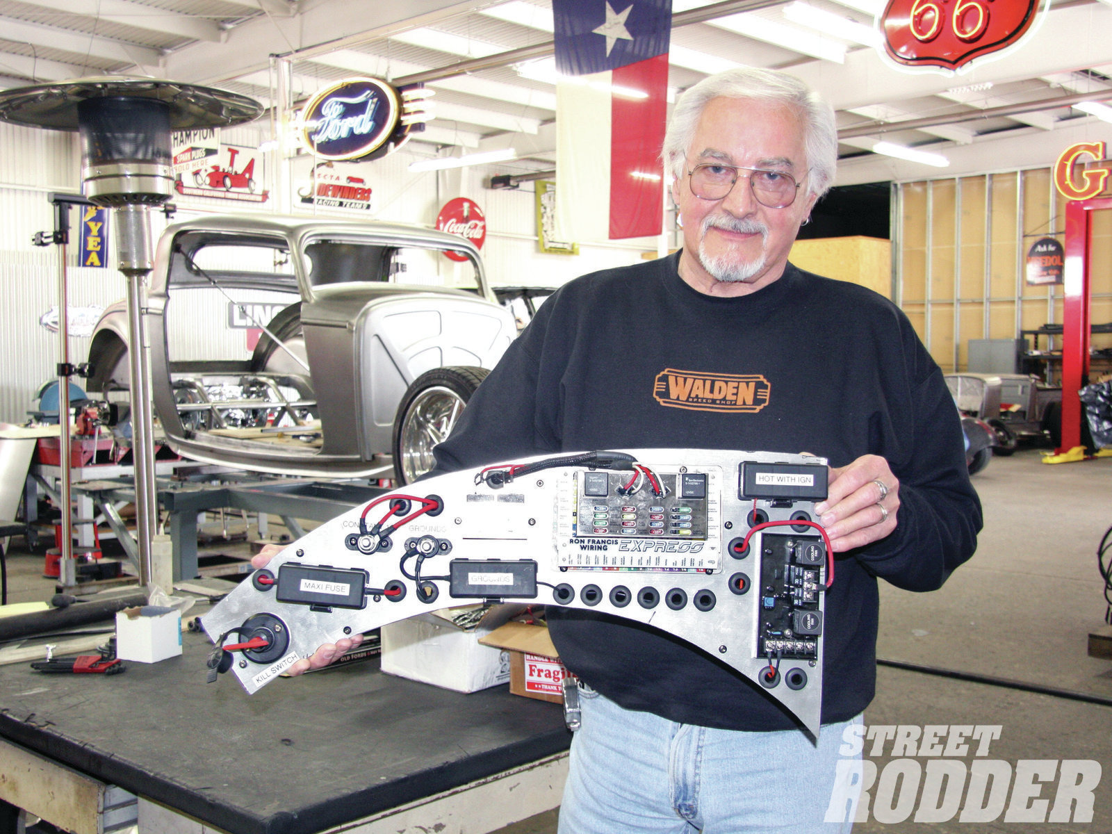 6| Warren likes doing electrical, and he made up several phenolic (non-conductive) panels to hold the necessary components, such as the Express wiring box from Ron Francis, fuses, kill switch, and so on. This one will fit inside the driver's quarter-panel.