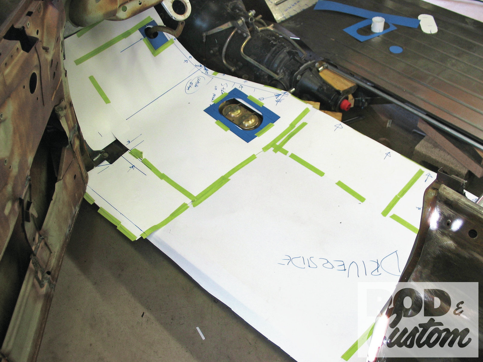 9. A posterboard template for each side of the floor was made, and openings for the frame-mounted master cylinder and booster were incorporated into the driver-side template.